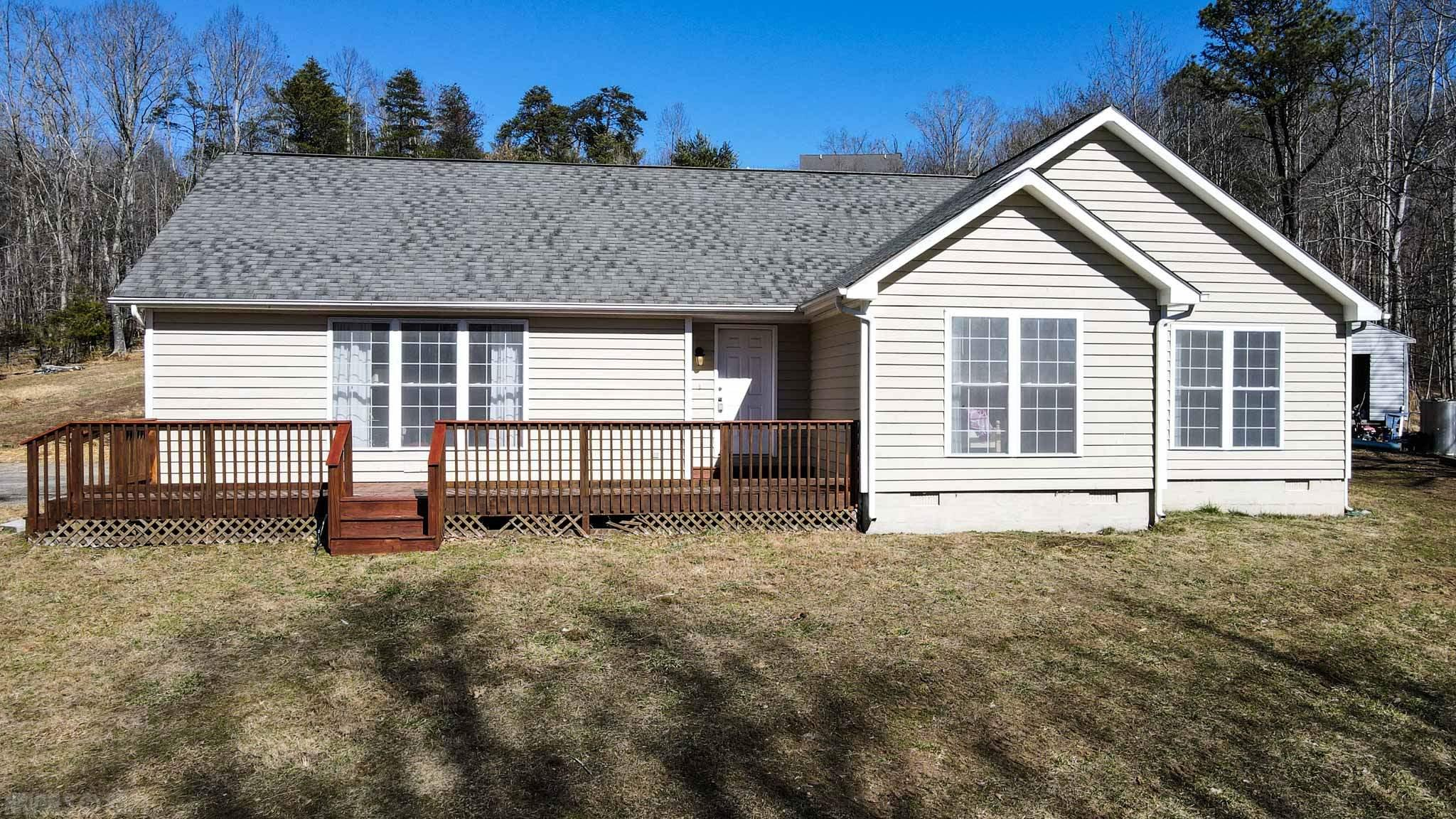 Just 10 country miles from I-81 for this Claytor Lake community. Nestled on 1.43 acres in a cul-de-sac setting for this comfortable living ranch home. The living room has hardwood floors, a gas log fireplace (no propane tank) and tall windows for lots of natural light & seasonal lake views.  The kitchen is open to the dining area with access to the back patio. Spacious kitchen with loads of cabinets & a country sink. The dishwasher is approx 1.5 yrs old.  The laundry room, with newer washer, & half bath are located off the kitchen and side door to outside. The hardwood floors flow from the living room to the 3 bedrooms.  The master suite includes a large private bath w/ garden tub, step in shower & walk in closet plus a closet in the bedroom.  A bonus room off the master could be an office, nursery, sitting room - you name it!  Check out the common area with your own boat slip.  Bring your water toys and get ready for summers at the lake.  Heat pump inside & outdoor units replaced 2014