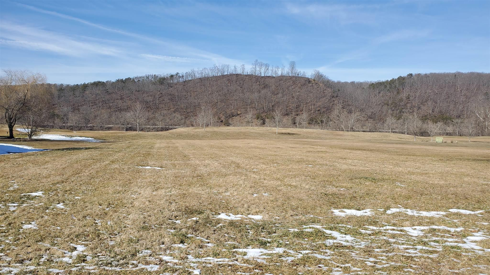 This is a rare opportunity to own an exclusive lot on the Golf Course . Come built your dream home on the 7th Tee Box and have beautiful views of the New River and Blue Ridge Mountains. HOA dues include pool membership