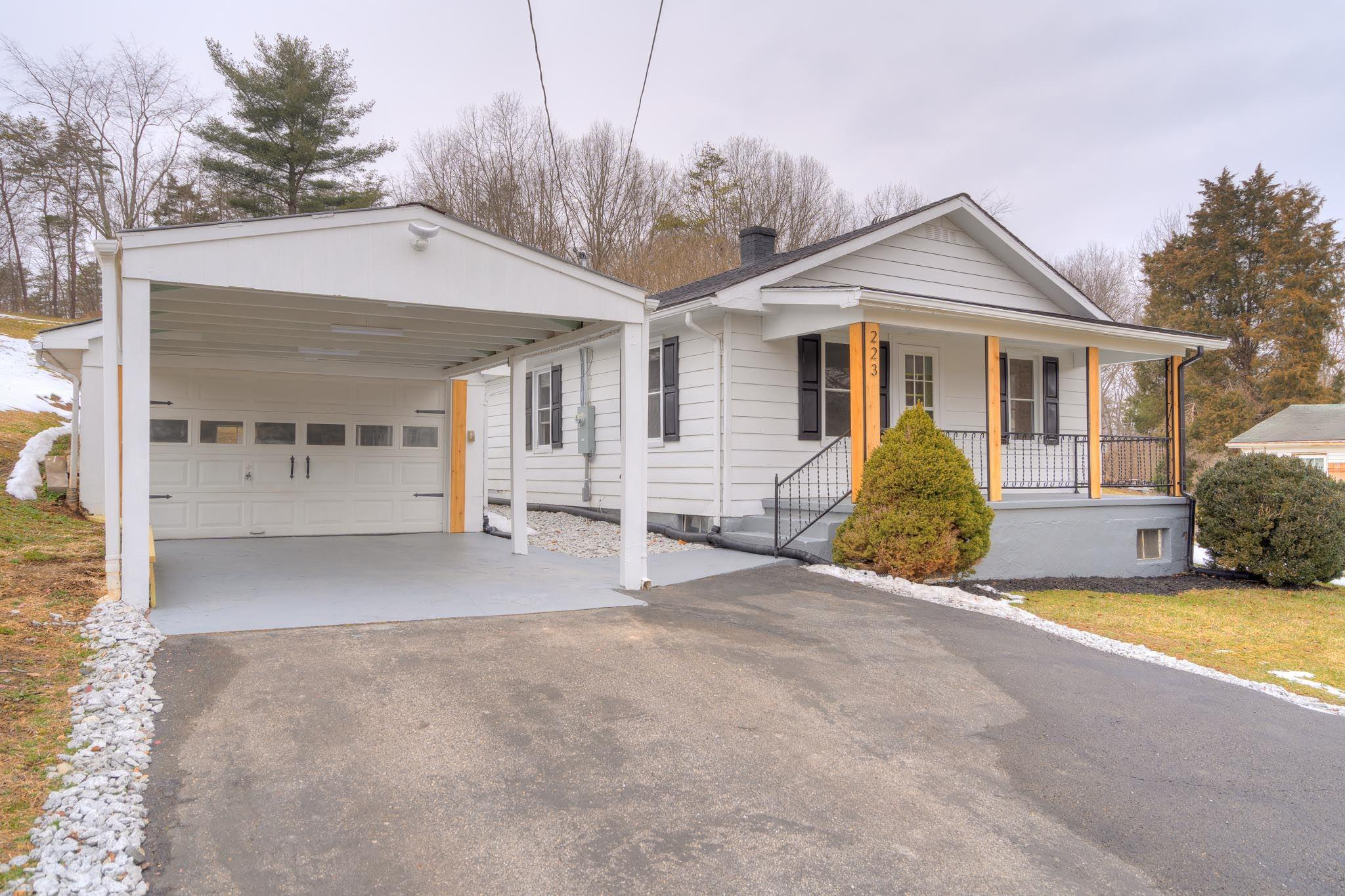 This completely redone bungalow is move in ready for you! Perfectly located, central to Radford, Christiansburg, and Blacksburg! ALL NEW: vinyl plank floors throughout, paint, windows, kitchen appliances, laundry wash tub, HVAC, well pump, sump pump, water heater and softener, plumbing, electrical panels, garage roof, landscaping! Enter via the large covered front porch, perfect for summer evenings! Spacious living room flows into the cozy dining room w/ custom fixtures! Completely renovated kitchen: new cabs, stainless appliances. Large pantry with rolling barn door, a gorgeous custom touch! Mudroom/laundry room off the kitchen walks out to covered back porch. 3 bright bedrooms; carpet in the master, 2 closets have new interiors! Large windows- so much light in this house!! Large carport and 1 car garage with a brand new roof. Country setting, but just minutes from local schools and all your shopping and restaurant needs.  This home won't last long- see today!