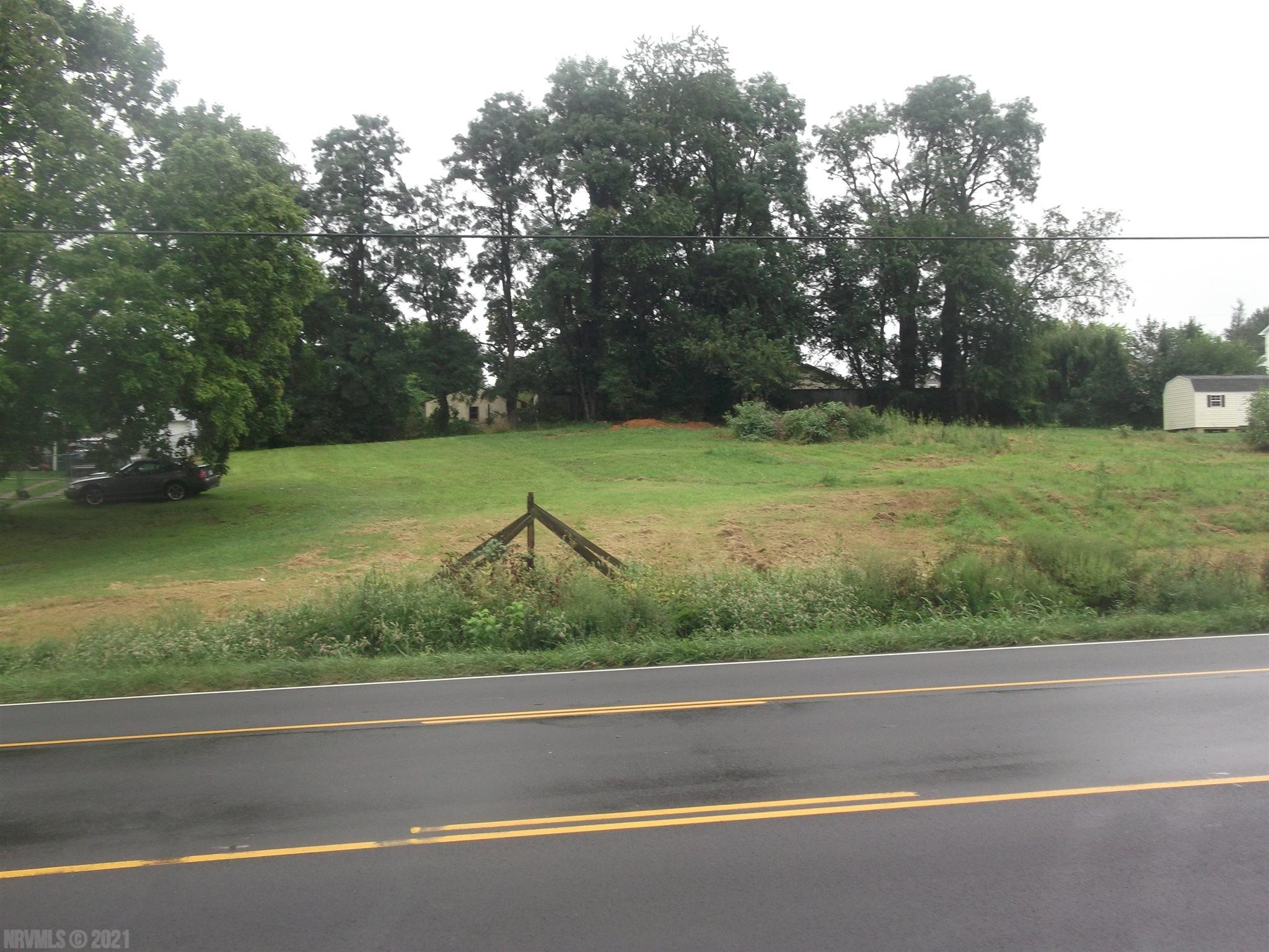 Prime location for this commercial lot along a main road.  Land lays well with a slight rise from the road.  Best use may be residential which requires a cup.