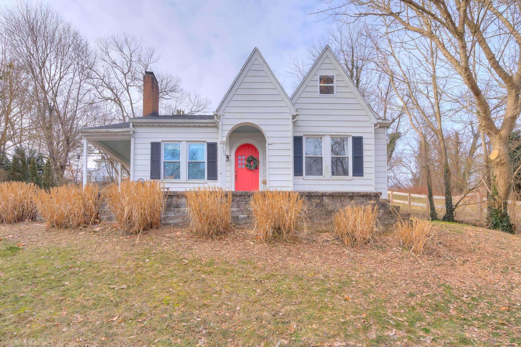 This Radford home has so much character and has been well loved!! Walking distance to Radford University, beautiful views, and lots of updates! Enter via the side door on the wrap around patio. Living room has brand new gas log fireplace, built in bookcases, and lots of windows. Curved doorframes and original, fully functional hardware lend to the character of this home! Walk through to a formal dining area, updated kitchen, and two bedrooms. Fresh paint, hardwood floors, insulated windows throughout. So much light! Bedrooms are bright and spacious. Head upstairs for a real treat--fully remodeled master bedroom space with a private half bath, large closet space, and reading nook. New vinyl plank floors, fixtures, windows, and paint. Partial basement for laundry, workbench, and storage. New hot water heater, new fence, new thermostat, and new gas logs. Roof in Nov 2018.  A sweet space, close to schools, local shops and restaurants, this is a must see!