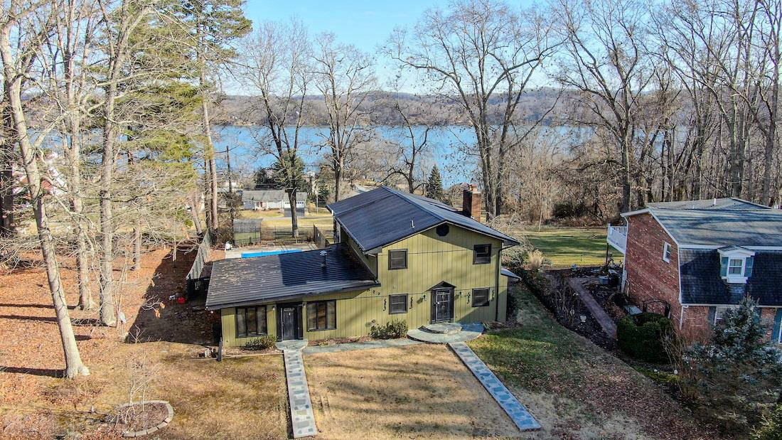 Online Only Auction Ending March 17th @ 4 PM.  Preview Dates-  Saturday March 6th @ 1 PM & Saturday March 13th @ 10 AM. You have the opportunity to purchase a stunning lake home for sale in Dublin VA! This home features 4 bedrooms, 2.5 baths and .48 acres. Enjoy the beautiful view of Claytor Lake each morning from your covered balcony. Feel the sweet, warm summer breeze coming up from the lake while you sip your morning coffee. The home is located just a few minutes from the Claytor Lake State Park. The home has a newer metal roof, and the exterior was painted in recent years. The large room by the kitchen could be used as a family room or as a dining room. It has a gorgeous brick feature wall with a wood fireplace. There is an addition to the home which could be used as a huge family room, game room or even a master bedroom. Upstairs there are 4 bedrooms. 2 Of the bedrooms have access to a shared balcony overlooking the lake. There is a full bath on the upper level as well. BID NOW!