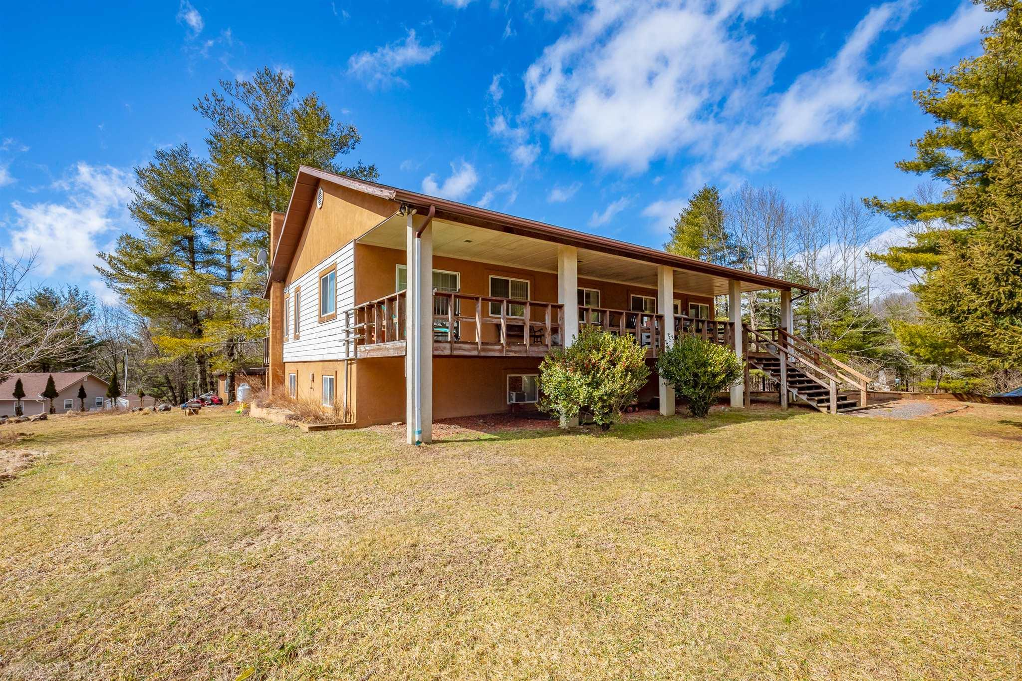 This secluded home has a beautiful nice size, level yard with plenty of room for a garden. On the front is a VERY large covered porch for you to enjoy the quiet and the wildlife. Inside you'll find a living room with nice size fire place, dining room and large kitchen with oak cabinets that will give you plenty of storage and a nice window over the sink. On the other side of the home you'll find a huge master bedroom and master bath -- all of these on the main floor. On the basement level you have two rooms (one does not have heat), full bath and a family room with wood stove. The two car attached garage is a very nice size with actual room for your cars as well as the laundry. With some TLC this could be your perfect second home for large families or full time home. Also possible purchase of additional 3 bed 2 bath cabin.