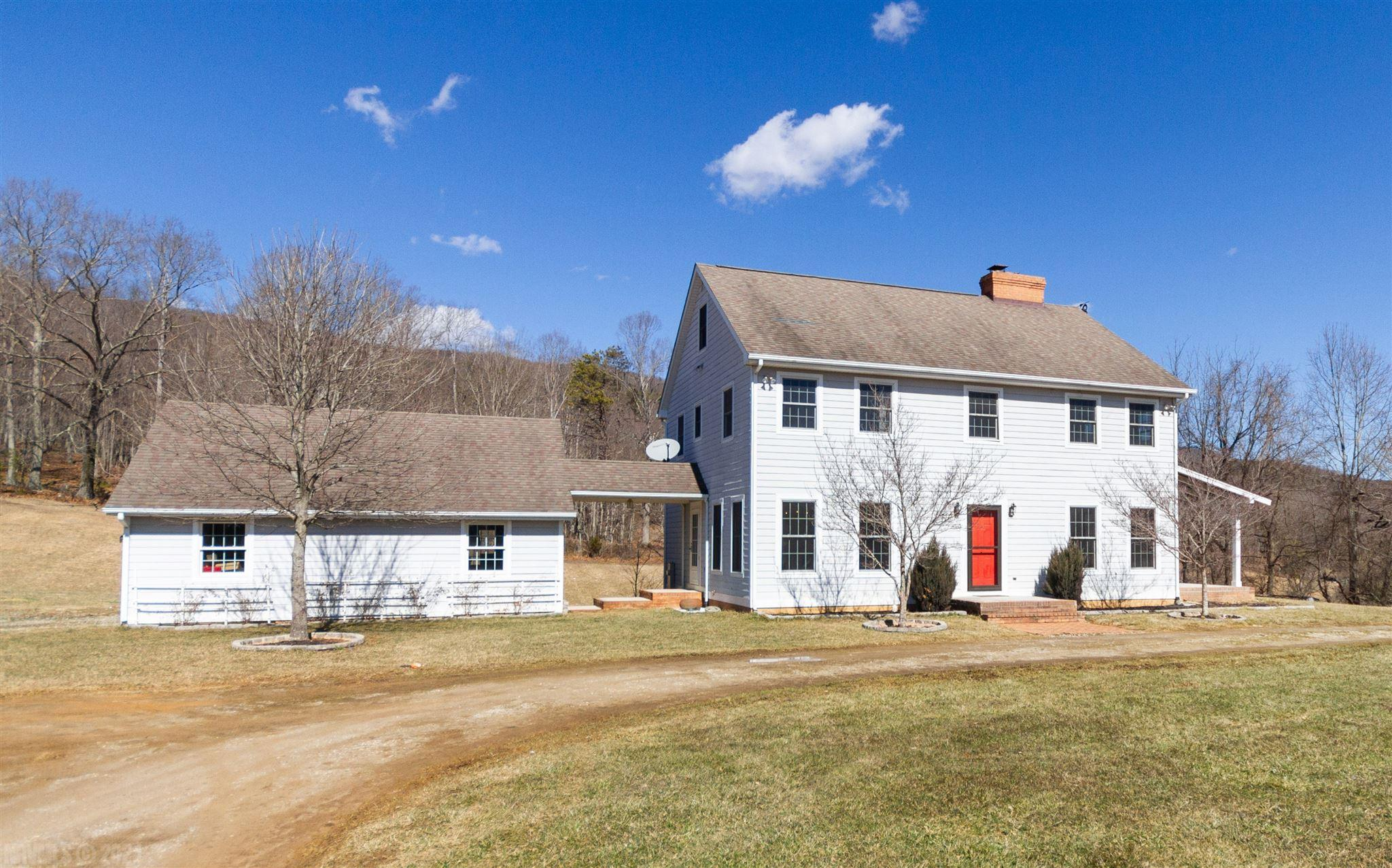 5 Flat acres of beautiful land and this traditionally styled house sit wonderfully together located only a few minutes from downtown Blacksburg.  Come experience country living close to town.