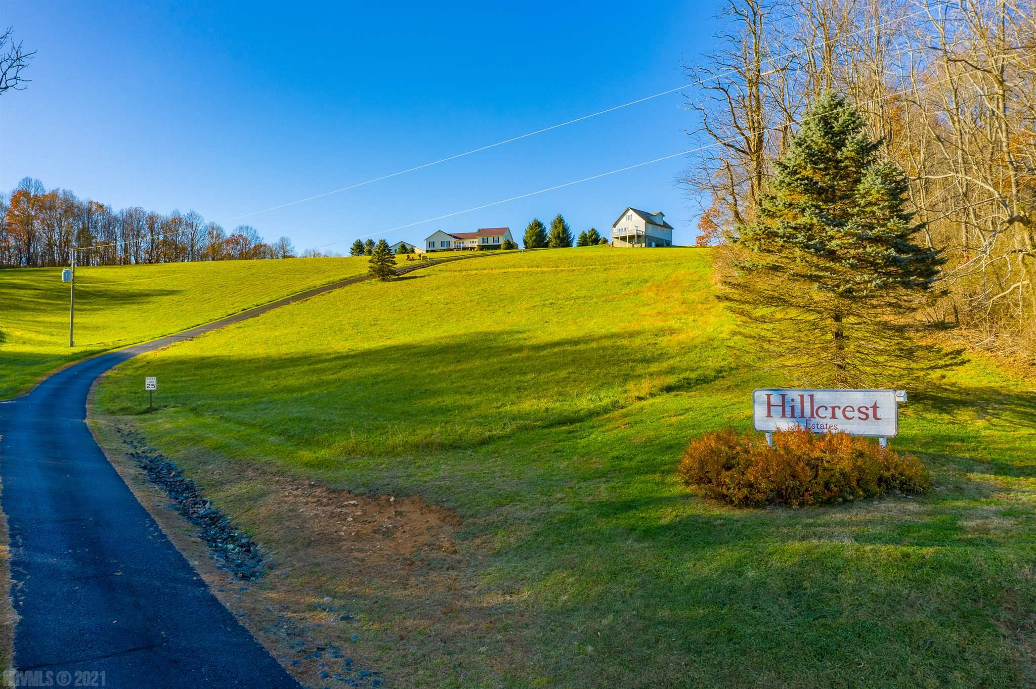 Beautiful and quiet country property located in prestigious Hillcrest Estates overlooking farm and distant view of mountains. Property is cleared with fescue grass ready for building. Community water with the HOA, road maintenance and snow removal. Property offers easy access to Hillsville, Blue Ridge Parkway, one of the best Golf Courses in the country, Olde Mill Golf Resort is just 20 minutes away. A true must see in a simply gorgeous area.  The land was actually originally owned by the Sheriff from the infamous courthouse shooting so you're owning a piece of history, very unique opportunity. Call to make your appt today!!