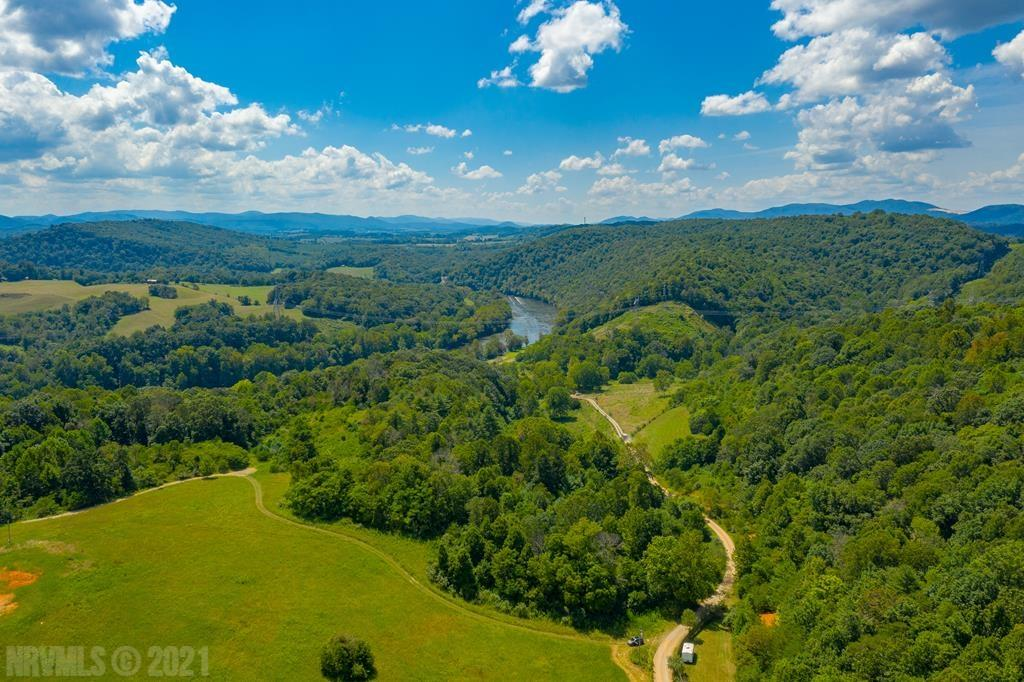 Nudged right against the New River is this remarkable 10 acre property. Mostly wooded land provides great privacy. Access to the river is deeded via the River Hills community area, making this an exclusive point of the New River that you'll feel you can call your own. With unparalleled views and located only a short drive from great shopping and amenities, this land is versatile and ready for your creativity. Set up an appointment to look at it today!