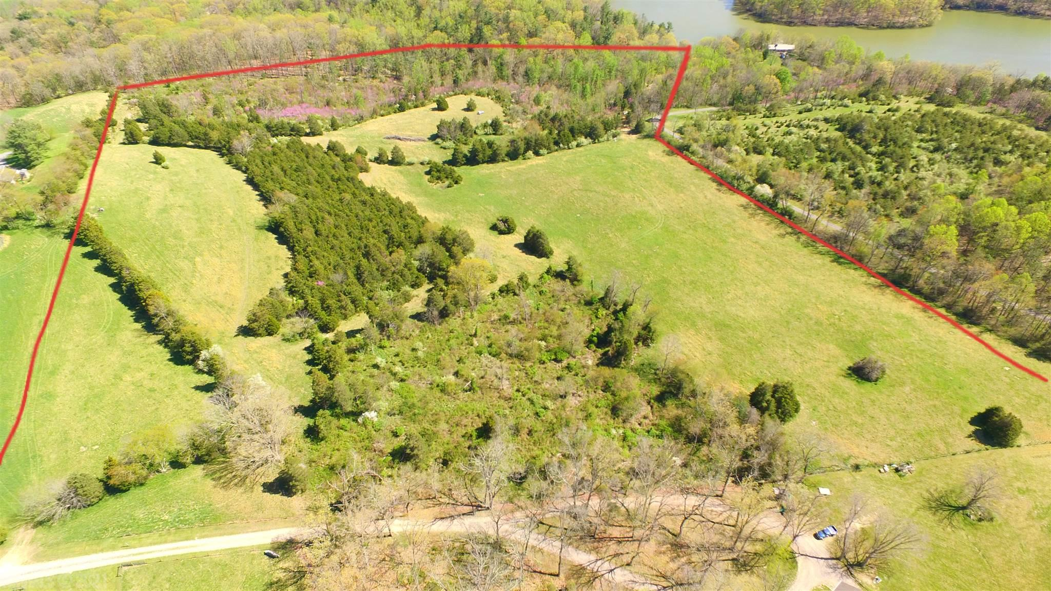 Beautiful 34.03 acres of land with multiple building sites, killer views, and lake access.  Very private yet so convenient and near new Hurston equestrian center.  Perfect for custom home and some horses.  Has lake front on Peak Creek and several years ago obtained dock permit but never built one.  Surveys and documents available.  Lovely land, lovely location.
