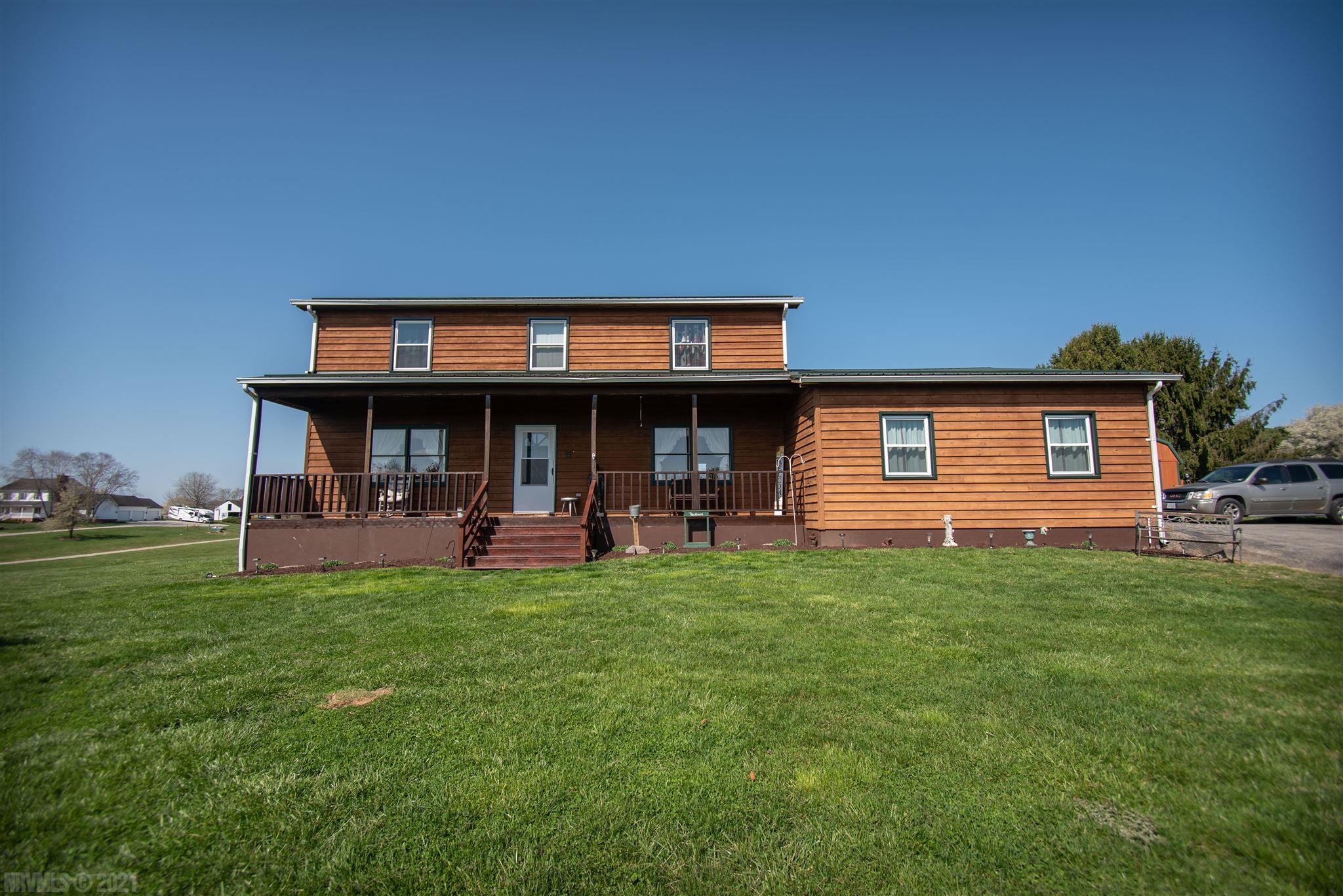 Enjoy the privacy and serenity this 4 bedroom 2.5 bathroom home has to offer. This one owner home has beautiful views from all 3 covered porches, 5.62 acres with endless possibilities, spacious rooms and so much more. Come see for yourself!