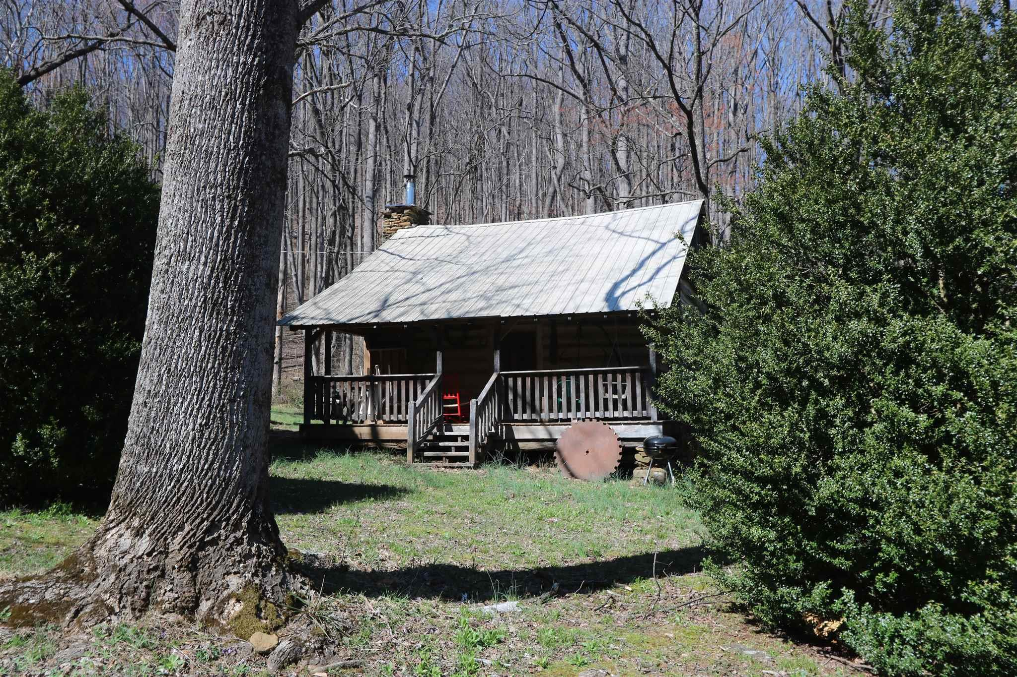 Charming Civil War era cabin with power, water and full bath on 19+/- acres on a private dead end road.  This place has lots of character and privacy but with good access.  Enjoy the peace and quite of the mountains in this log cabin home.  Come hike the woods and wade the brook.