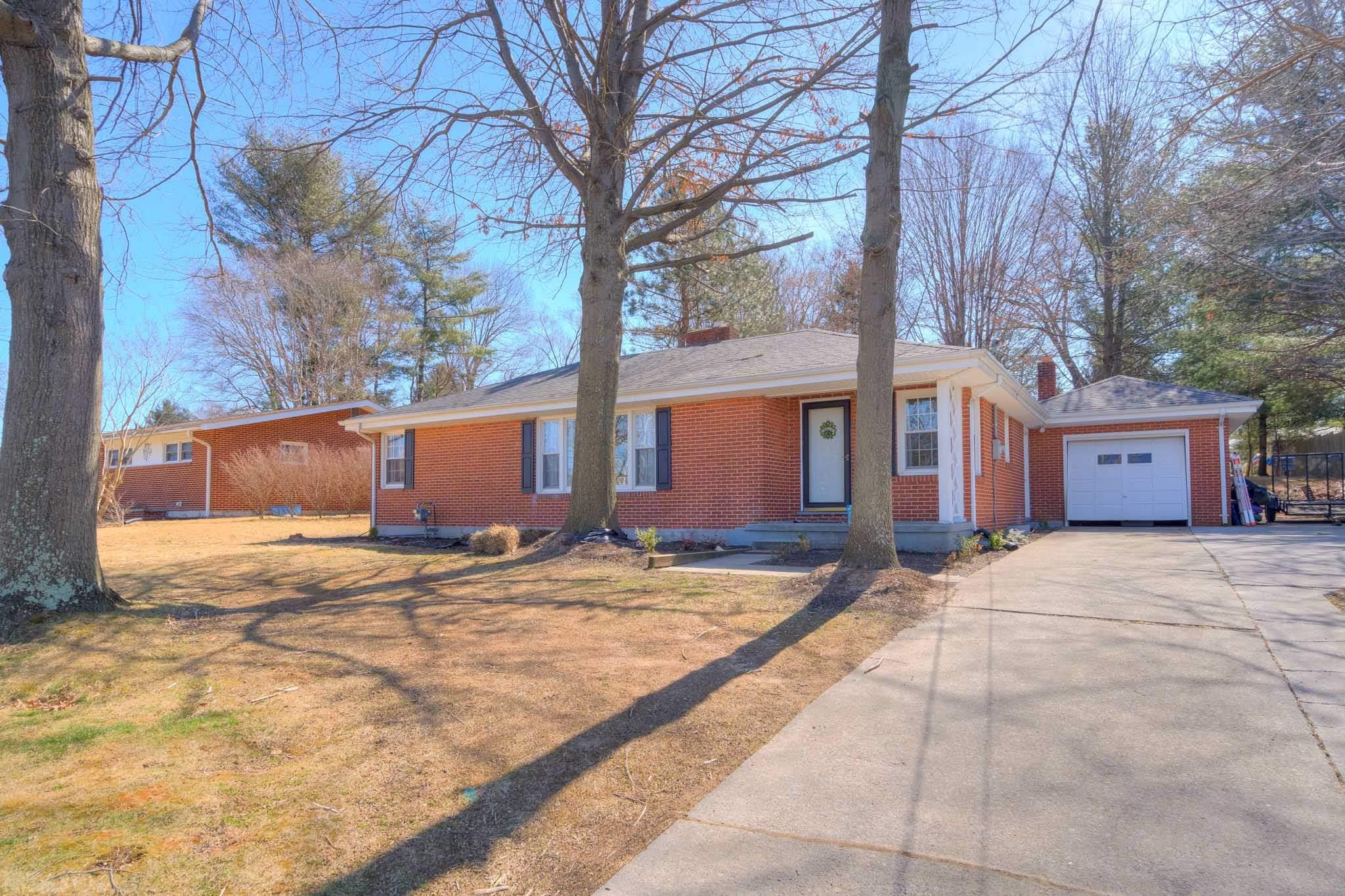 This charming move-in ready brick ranch boasts 3 bedrooms, 1 bath, with an attached garage and an unfinished walk- out basement full of potential. The flat yard offers mature trees great for shade on a warm summers day and a patio made for entertaining. With freshly finished hardwood floors running the main level of the home, this gorgeous house has style and functionality. The kitchen is outfitted with stainless steel appliances and located right of the bright and cheery sunroom. Schedule a showing today! This home will not last long!