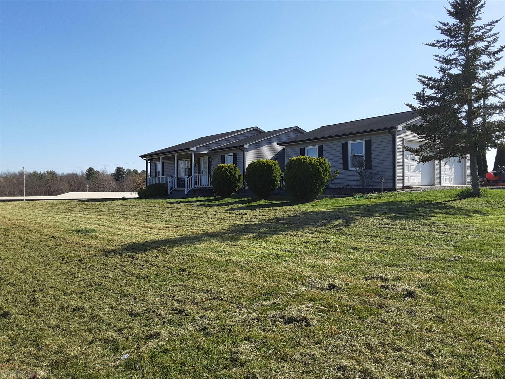 Come enjoy this large one level home with 2 car detached garage, within walking distance of Pulaski County High School. This home, built in 2003, offers 3 bedrooms, and 2 baths on a large 1.81 acre lot. The home has a tremendous back deck, excellent for entertaining or enjoying the evening sun.  The front porch is perfect for enjoying that first cup of coffee while watching the birds sing in the front yard. Mature trees include Willows, fruit trees, and more to go with the mature landscaping around the home. This home is perfect for everyone, as this is one level living at it's best. Will you be the next person to call this home yours?