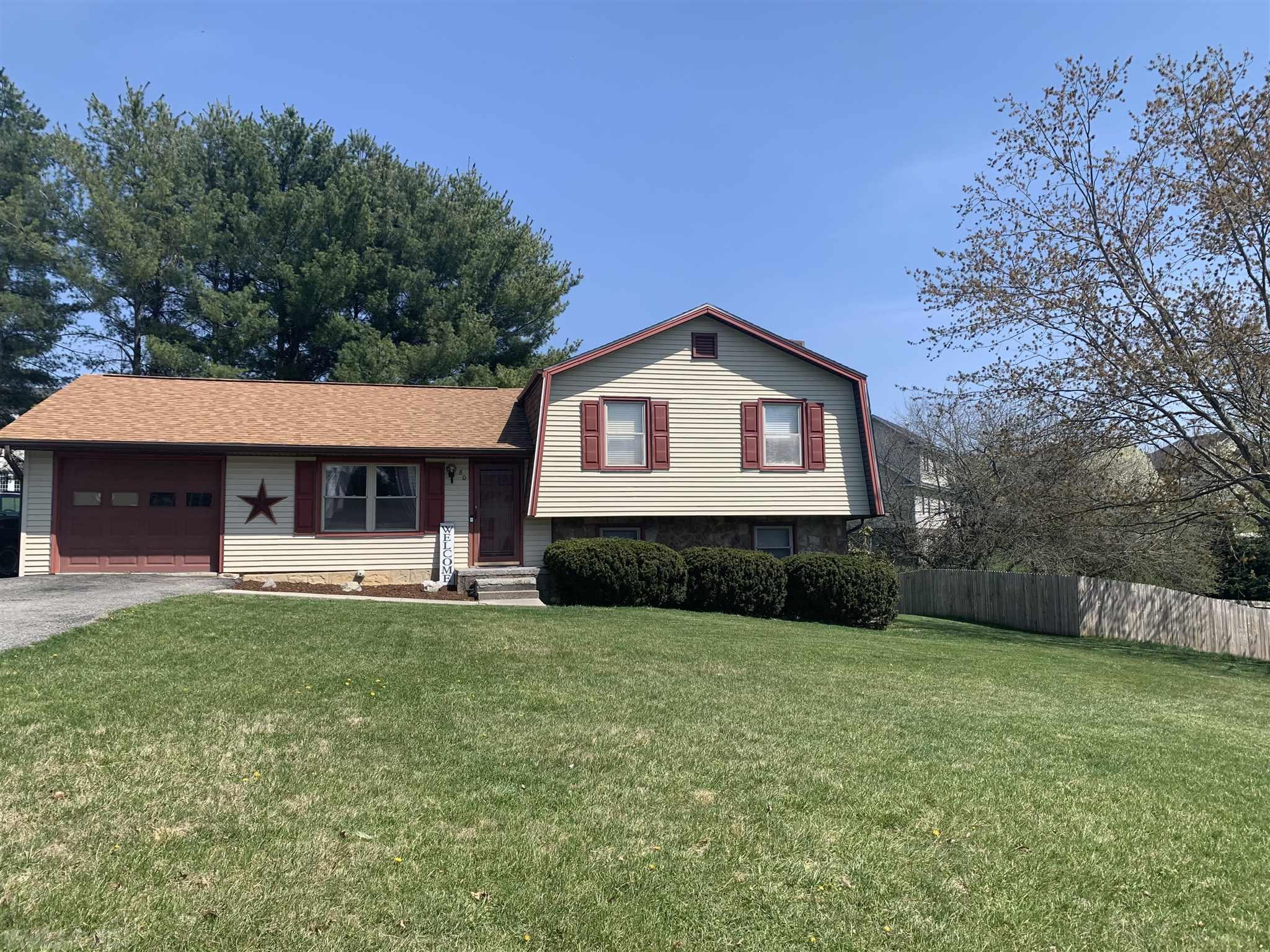 This beautiful home is move-in ready.  It features 3 bedrooms, 2.5 baths and over 2,200 square feet.  New deck in late 2018, new roof in the summer of 2017. Located in Windmill Hills, it close to shopping, schools, VT and I 81. Imagine watching the kids play in the back yard while you BBQ on your new deck.   If you're looking for the perfect home for your family.  This is it.
