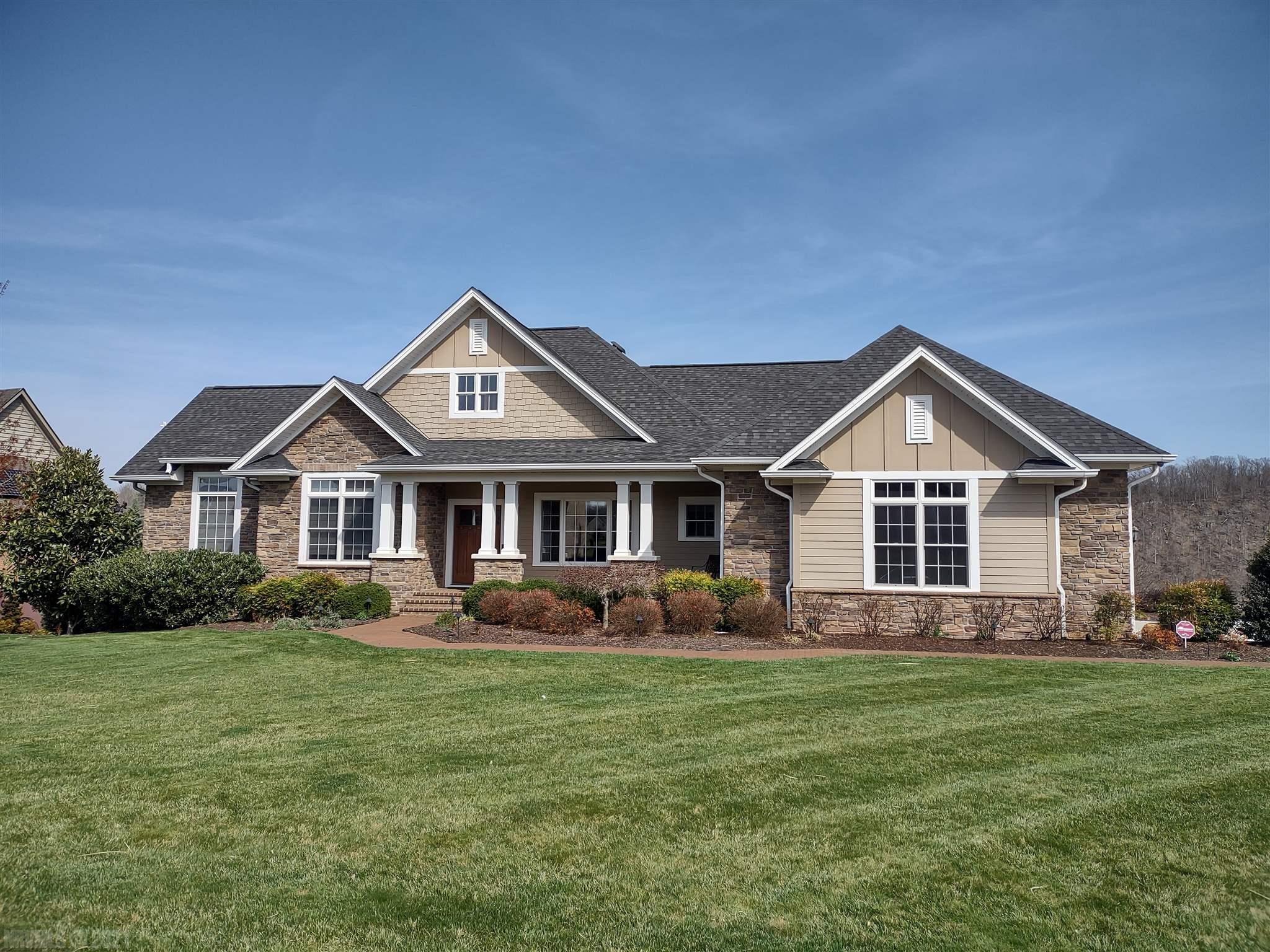 Gorgeous Mountainside Ranch on one of the most beautiful lots in the New River Valley overlooking the Pete Dye River Course of Virginia tech.  Everything in this home is custom and the views are breath taking.
