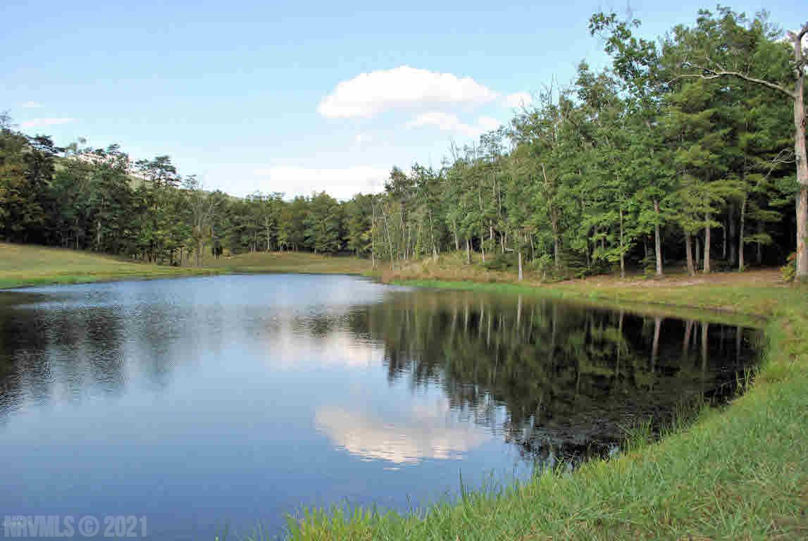 This private 24.378 acre tract of land has a large pond, a shed with great pastures and views and is also partially wooded. Perfect for your estate or mini farm for horses! Nice hay field too and shed. The property has been perked in three different areas and is ready for your dream home!