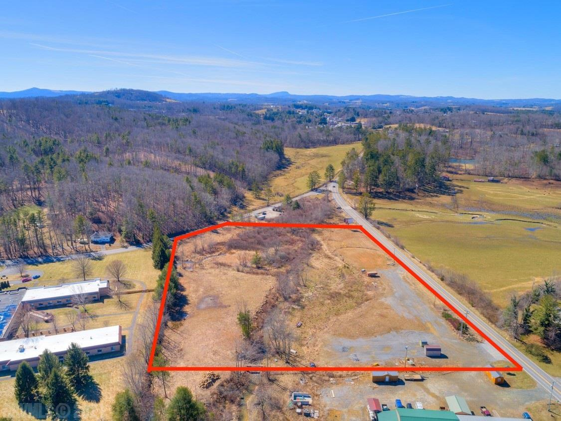 "SELLERS SAY ""BRING AN OFFER"" Fantastic level build site 1/3 mile outside of the Town of Floyd, with plenty of possibilities on this 6.91 ac site. Four parcels in total, with two high-volume entrances on Floyd Hwy N, as well as one medium volume entrance on Franklin Pike. Zoning allows a multitude of uses, including manufacturing, industrial, office/retail, and more, making it perfect for a turnkey operation - just BTS and go. Three-phase power at the street, along with 8"" water and 8"" sewer, and 2"" tap at the power pole. Perfect location for brewery, manufacturing, storage, etc. Adjacent to Skyline Nursing and Rehabilitation Center."