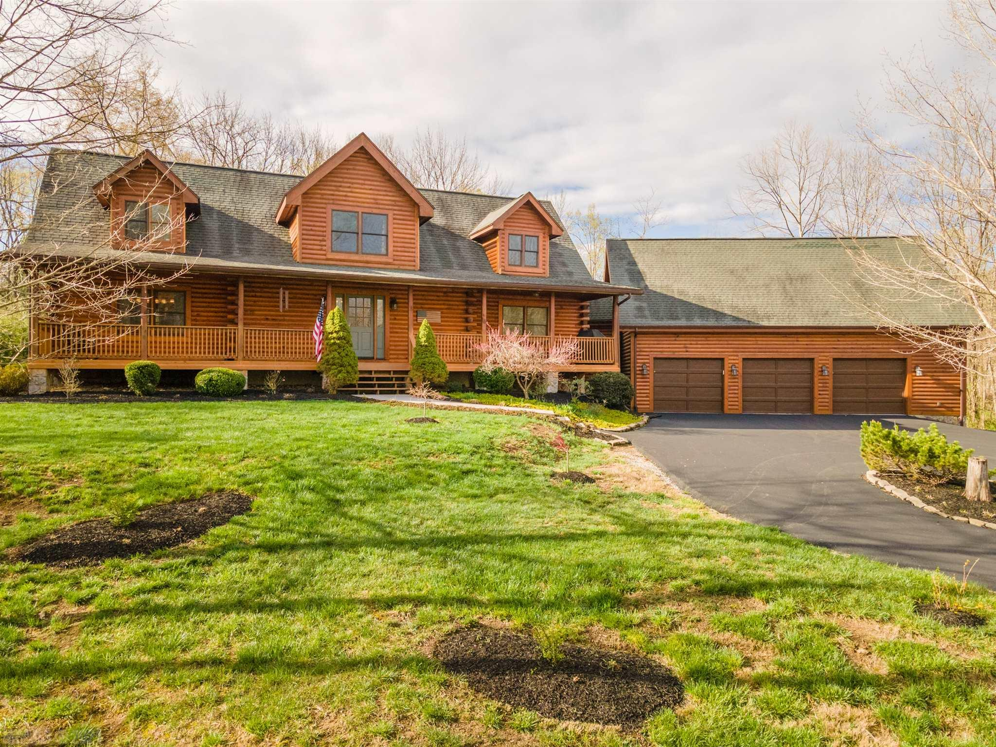 Featuring many new updates, this stunning 4 BR, 3.5 Bath log home on 1.34 acres is ideally located 1.6 miles from VT and offers quick easy access to I-460 and charming downtown Blacksburg!  As you walk through the front door, prepare to be wowed by the massive living room with vaulted ceilings, stone gas fireplace, and beautiful hardwood floors. A gourmet kitchen features granite counter-tops, stainless steel appliances, gas cook-top, custom cabinets and a breakfast bar. The main floor master suite boasts a large walk-in closet and beautiful master bath with soaking tub and double vanity sink. Upstairs you will find a loft, two large bedrooms, and a full bathroom. A family room, full bathroom, and a bedroom over the triple car garage is the perfect retreat for guests or as an in-law suite. And the open floor plan, expansive covered porch, brand new deck, & fenced level yard are great for entertaining friends and family! Don't miss your chance to make this your forever home!