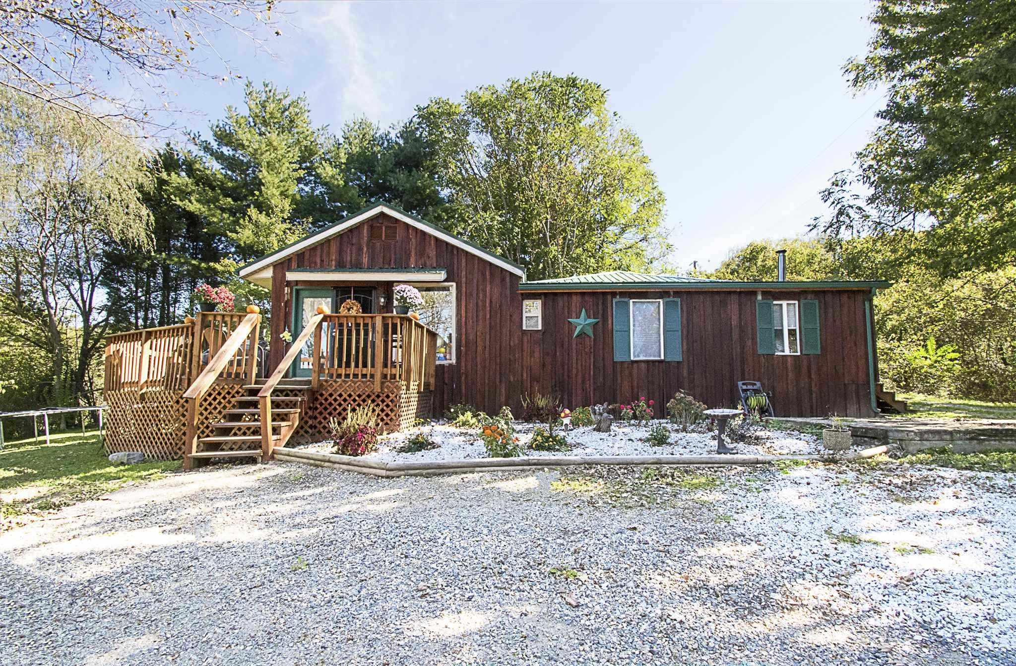 Cozy two bedroom house on 15 acres. Great mountain view! Lovely hardwood floors. Remolded kitchen and bathrooms. One level living. Large Deck and yard with plenty of space for outdoor entertainment. New metal roof in 2018 and multiple storage buildings.