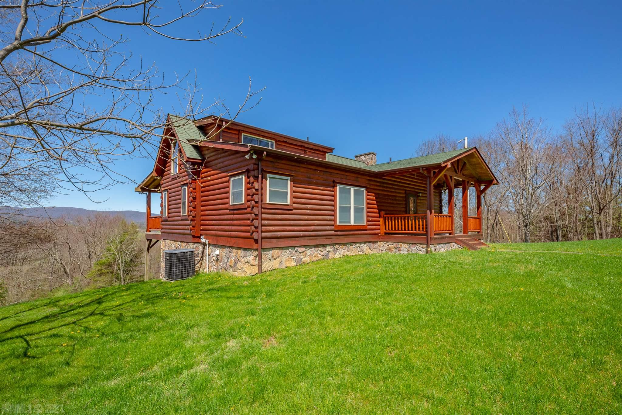 You will not find a more secluded home on the market! This cabin sits right in the middle of over 71 acres. The views here are stunning. This place is a hunter's paradise. There are many permanent hunting stands on the property, as well as lock on ladder stands, and an abundant amount of feed plots and apple trees. The cabin itself is extremely well built. Every block has poured concrete in the foundation. You have an open floor plan through the main level, with everything you need. The basement is ready to be finished as well, if more square footage is desired. There is framing in place for windows and doors, as well as a garage door that's ready to go. You can customize it to your own needs. The 2 potential bedrooms and full bath downstairs are about 80% finished (not counted in the listing). There is a 35X32 structure that's perfect for equipment. There are also 2 small streams and a small pond on the property. You must see this home and explore the property to truly appreciate it!