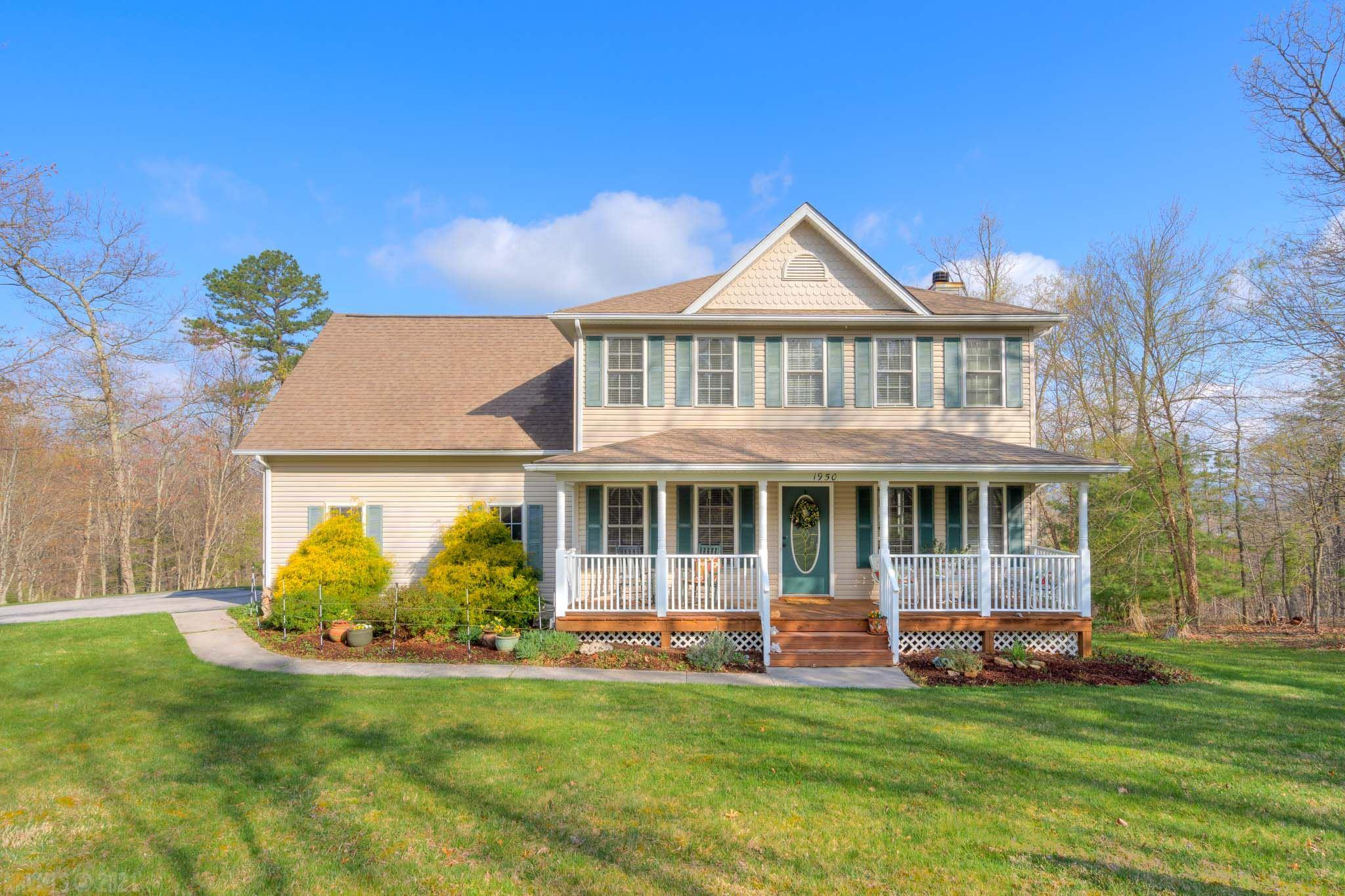 Come see this one-owner home in Blacksburg on over 2 acres with views!  4 bedrooms, 2.5 baths, double-attached garage and a full walk-out basement.  Hardwood floors throughout the main level with an open kitchen and living room.  Upstairs is the owner's suite and 3 additional bedrooms.  The basement features a family room, half bath and unfinished storage.  Relax on the covered front porch or back deck.  Situated in a quiet, wooded neighborhood just minutes to Montgomery Hospital, 460-Bypass, Downtown Blacksburg and VT.