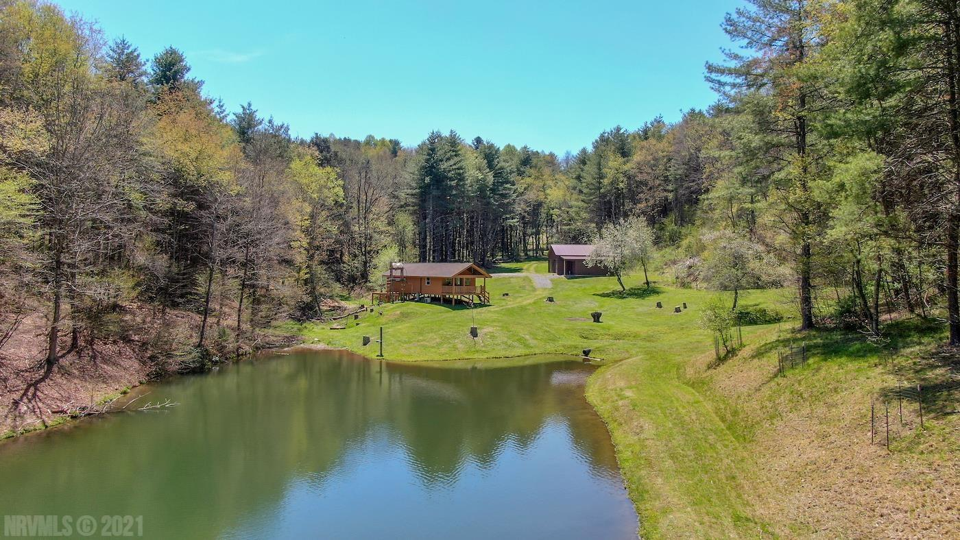 Take a look at this ultimate recreational retreat for sale in Indian Valley VA! This property features over 80 acres of mostly wooded land with a cabin and large shop building. There is a well and spring along with a septic and electric. The property has food plots, tree stands, springs, a stocked pond, trails and more!! The cabin has 1 bedroom. It has a very open and spacious kitchen and living area. Kick back on your covered porch while overlooking your beautiful pond. This property is excellent for hunting, fishing, camping, etc. Wildlife is abundant with whitetail deer, black bear, turkey and more. This property is turn key! Even the rocking chairs on the front porch convey! Items to convey include 3 four wheelers, Kubota tractor and much more. The john deere mower does not convey.