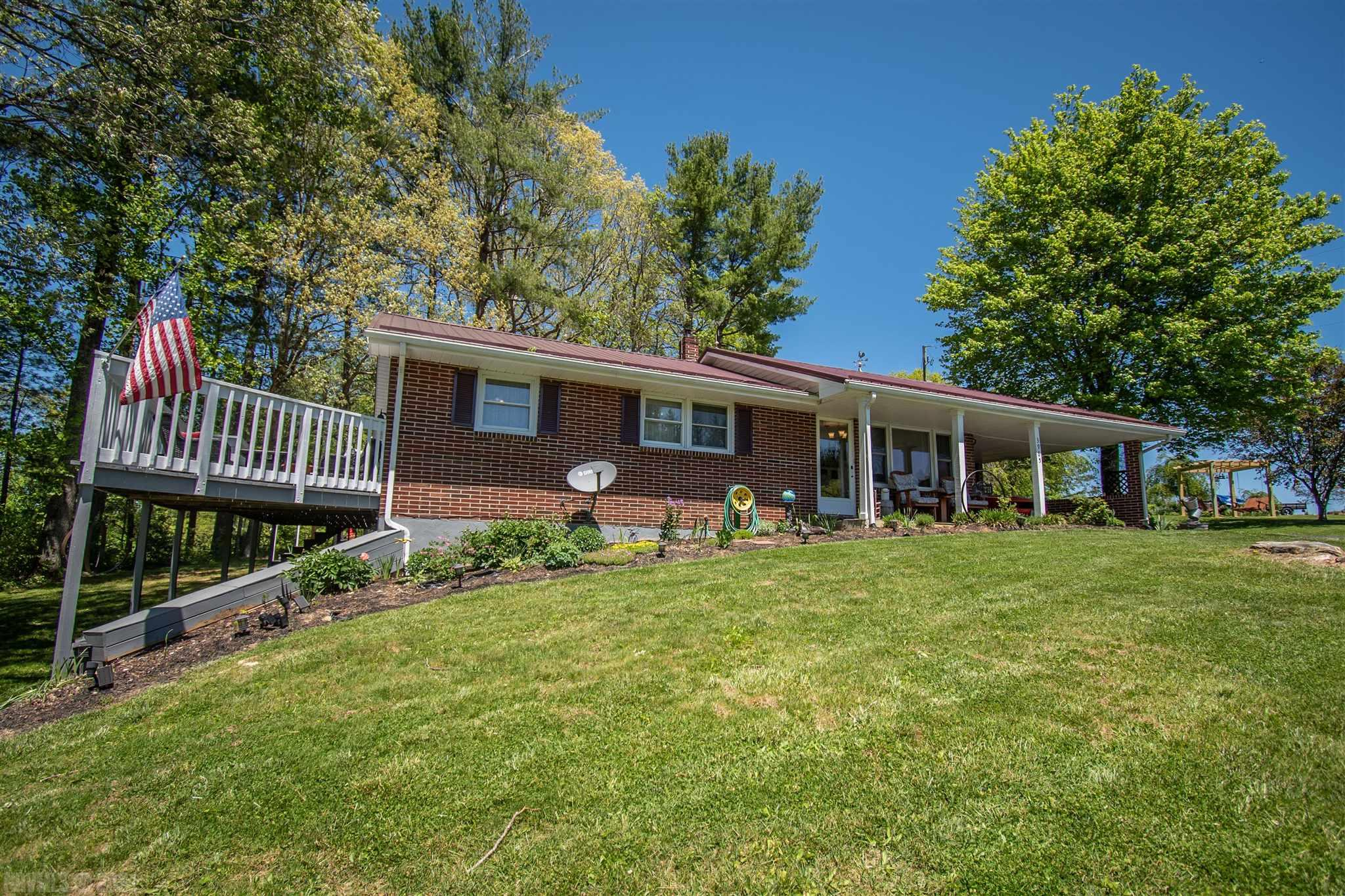 Beautifully remodeled brick ranch on a private .83 acre lot conveniently located between Christiansburg and Floyd.    Many recent improvements include a whole new kitchen, cabinets, stainless appliances, new countertops. There is a  new HVAC, hotwater heater,  new flooring and paint, updated lights.  The sunroom off the kitchen is delightful.   Metal roof and replacement windows.     The basement has plenty of storage and hugh family room.
