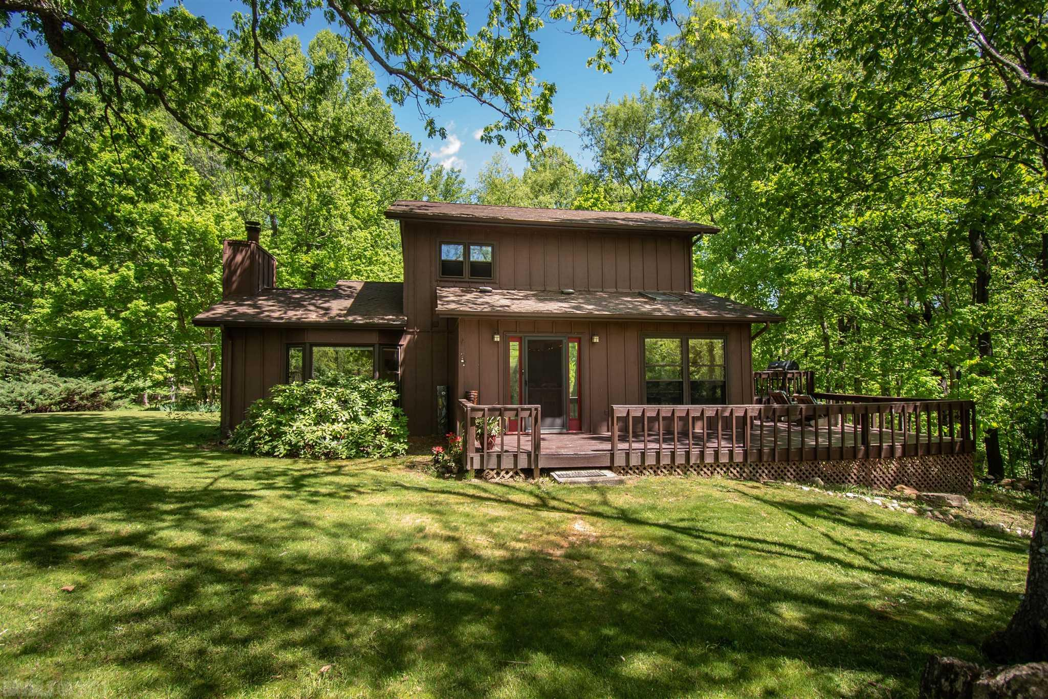 This home is perfect for nature lovers or anyone who enjoys the feeling of the country. Enjoy the recently updated deck that overlooks the beautiful fish pond and secluded wooded area. This home includes a two-car garage and a stunning architectural design that can be seen outside and inside of the home.  Also included is a breakfast bar, a full bathroom and master bedroom on the main floor, and two bedrooms with full bath on the second floor. Enjoy this home just in time for summer!