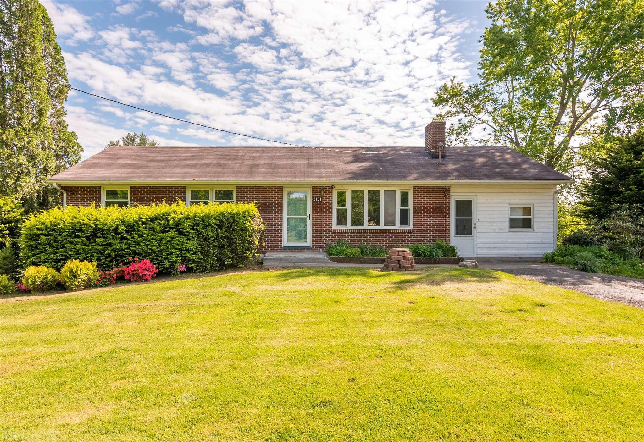 This charming, 3 bed/2 bath brick ranch, which sits on 2+ gorgeous acres, with a double driveway is ready for its new owners! With nice hardwood floors, tons of natural light through the replacement windows, newer HVAC for heat and air on the main floor (2014) and a cozy wood burning fireplace in the living room, this place is a gem. The main floor features three spacious bedrooms and a full bathroom, a living room with a fireplace, a den/rec room, and bright and airy kitchen. The basement has tons of potential and is perfect for anyone looking to put their own touches on the space. Downstairs you will find a full bathroom, laundry room, a potential 4th bedroom, a partial second kitchen, and a wood burning stove for heat. Step outside to relax on the back deck, and enjoy the fire pit surrounded by fruit trees, a huge yard, and plenty of garden space. Septic just pumped and new line installed in April. The house is being sold as-is.   Great investment or first time home buyer property!