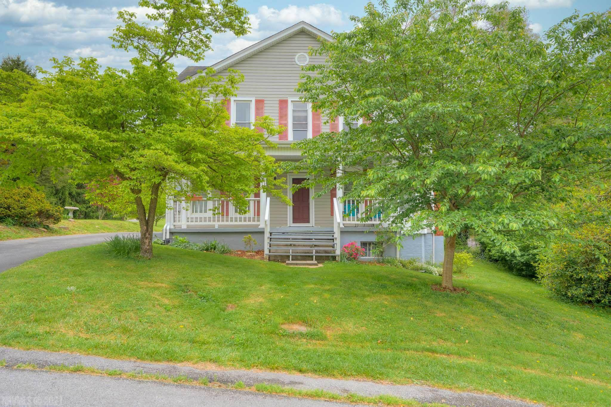 Come home to this classic 4 square home in the heart of Radford.   This lovely home with 1940 sqft with 3 bedrooms, 2 full baths has all the room you'll need to live comfortably.  Original hardwood floors, and a newer kitchen and bathrooms make it move in ready.  Hard to find touches include living, family rooms, original woodwork and more.  Oversized detached 2 car garage.  Laundry room on second floor!  Laundry room or main level family room could be converted to bedrooms if needed.  Large yard with nice landscaping and mature trees.