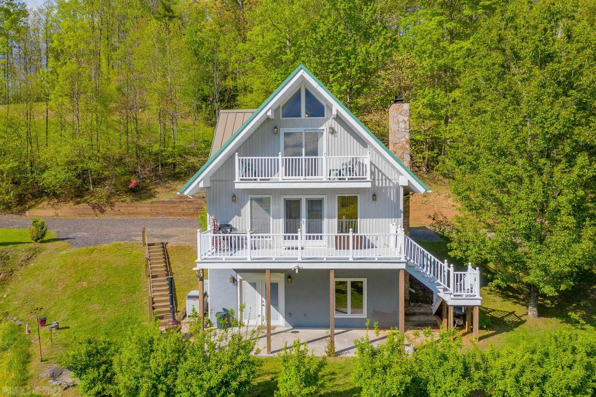 Beautiful Home with Mountain Views! Perfectly placed in Blue Ridge Mountains of SouthWest Virginia. This Chalet style home is in a great location offering seclusion and accessibility to all the major attractions of the Blue Ridge. The home offers plenty of space inside and out, laid out perfectly for a second or primary residence. Beautiful Red Oak floors cover the main and second floors. This home comes move in ready with nearly all furnishings! Enjoy the peaceful mountain view from the Balcony, Deck, or Patio. If privacy is your priority, this property offers close to 4 acres for your enjoyment. A convenient storage shed is also located at the end of the drive, matching the exterior of the home. With power and water already accessible, the shed would make an excellent tiny guest house! Offering plenty of room for you and your guests, and a great family/entertainment room in the finished basement. This mountain home truly has it all!