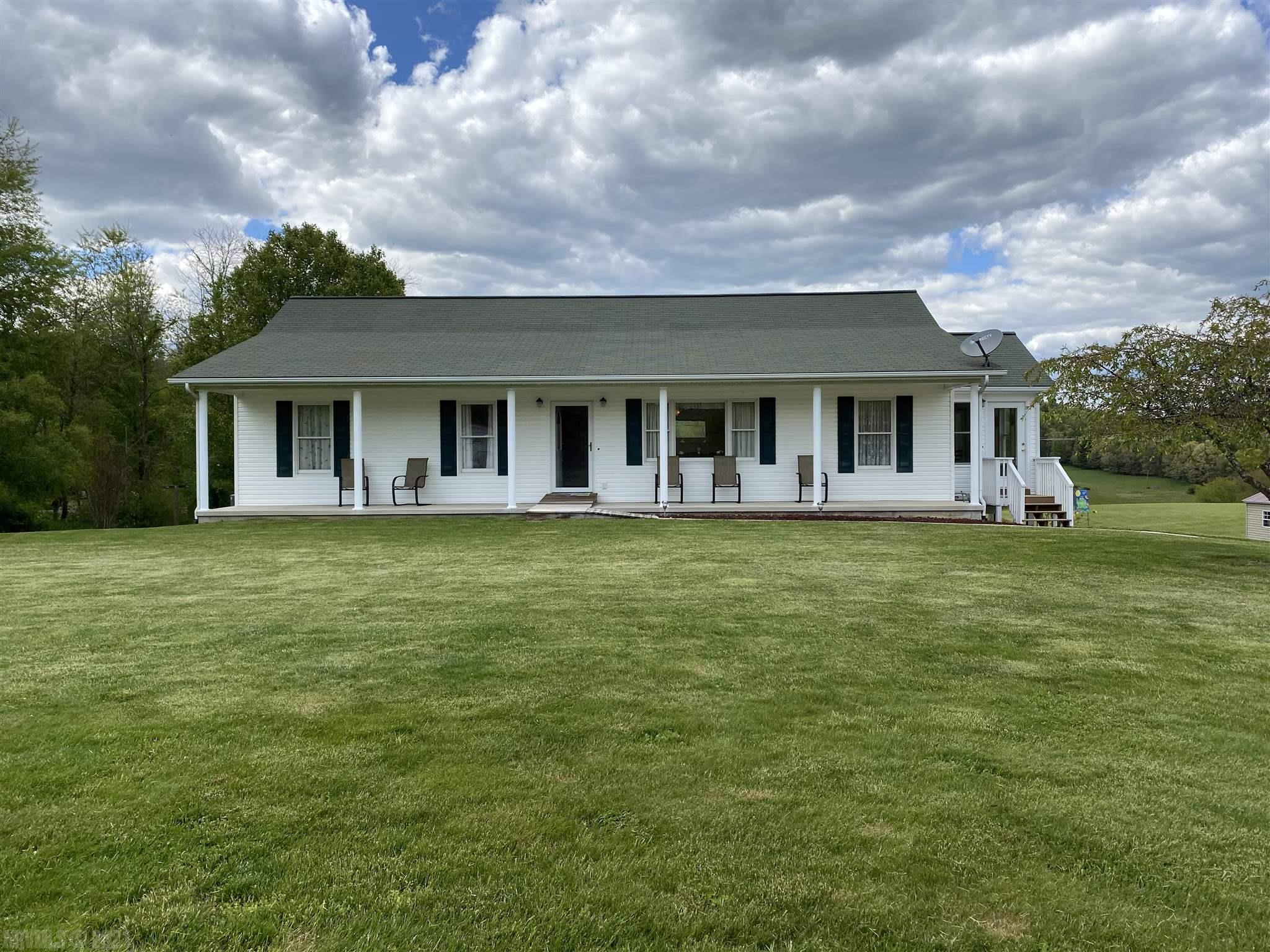 Move-in Ready home with beautiful mountain views. Well cared for and clean as a whistle. 2 BR, 2 full bath on 1.63 acres. Two-car garage. Only minutes from I-77.  Quiet country living at its finest.  This one won't be available long.