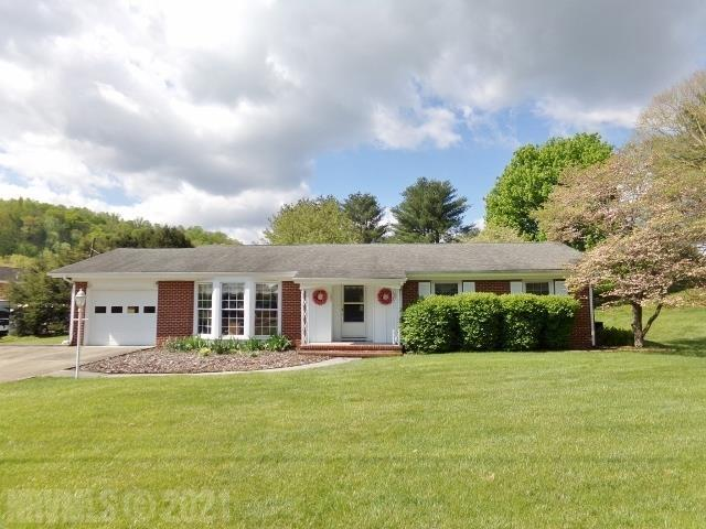Great location! Spacious Brick Ranch on 1.2 acres. Lovely hardwood floors. Updated Kitchen w/new stainless dishwasher & seller installing new stainless oven. Dining RM w/gas logs. Huge back patio. Large Workshop/storage building w/concrete floor & electric. Att Garage w/double concrete drive.