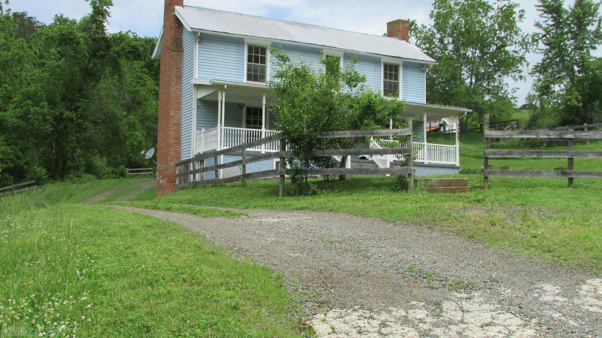 Large farm house  with 21.15 acres of land. Part of land is used for hay. Has a pole barn with a finished room .Another pole shed for shelter for your horses. Located only 3 miles from I-81.Fireplace in the family room. This house need some TLC. Owner is in the process of cleaning out the house and getting the mowing done. THE HOUSE IS BEING SOLD  IN AS IS CONDITION. TAKE A LOOK AND SEE ALL OF THE GREAT POSSIBILITIES THAT ARE HERE. The would make a great horse farm. The owner had horses for many years. Located only 3 miles from I-81.