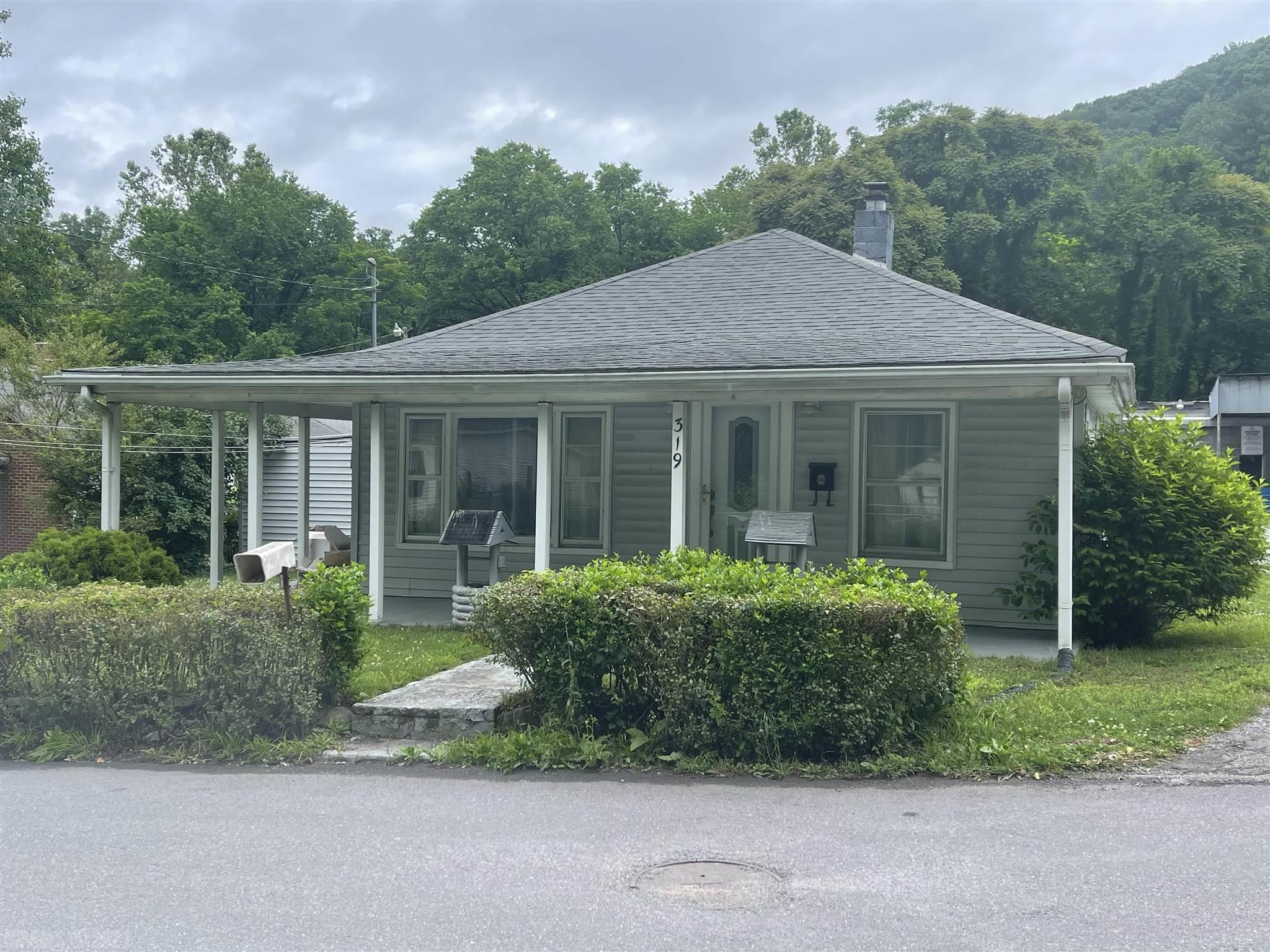 Older home with lots of possibilities, 2br,2ba, carport, beautiful hard wood floors, small screen porch, work shop for your handyman! Call today!