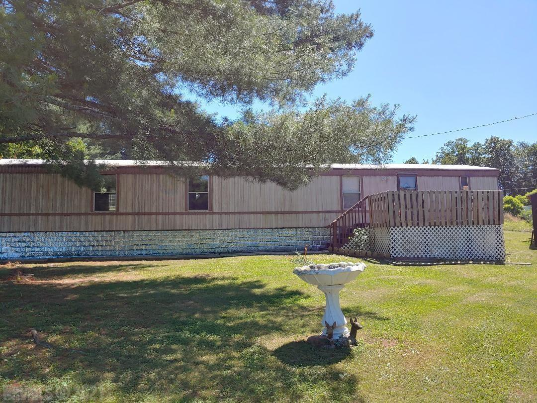 Owner selling property AS-IS.  Shared well & septic with 4487 Raccoon Place. Purchaser must verify all information. Good Rental history. Near Public boat ramp, Claytor Lake State park Beach / Marina, walking trails.