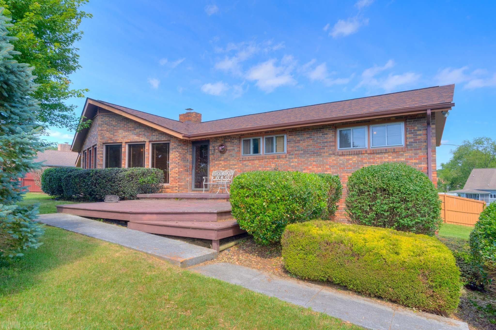 Located just minutes off the I-81 exit for Claytor Lake State Park in the popular Dunkards Bottom-Lakeshore subdivision, this home has a community dock just across the street and a community boat launch at the end of the street. This amazing home has been in the same family for over 40 years! Situated on a corner lot this brick rancher has much to offer. The open floor plan lends itself to versatility with lots of natural lighting. Oak parquet flooring, a large masonry fireplace, main level master suite complete with a walk-in closet, a private bath and main level laundry area allows for easy living. The basement has room for expansion and a well-sized two car garage. Enjoy lake living without the cost of owning and maintaining waterfront property! Family and golf cart friendly!