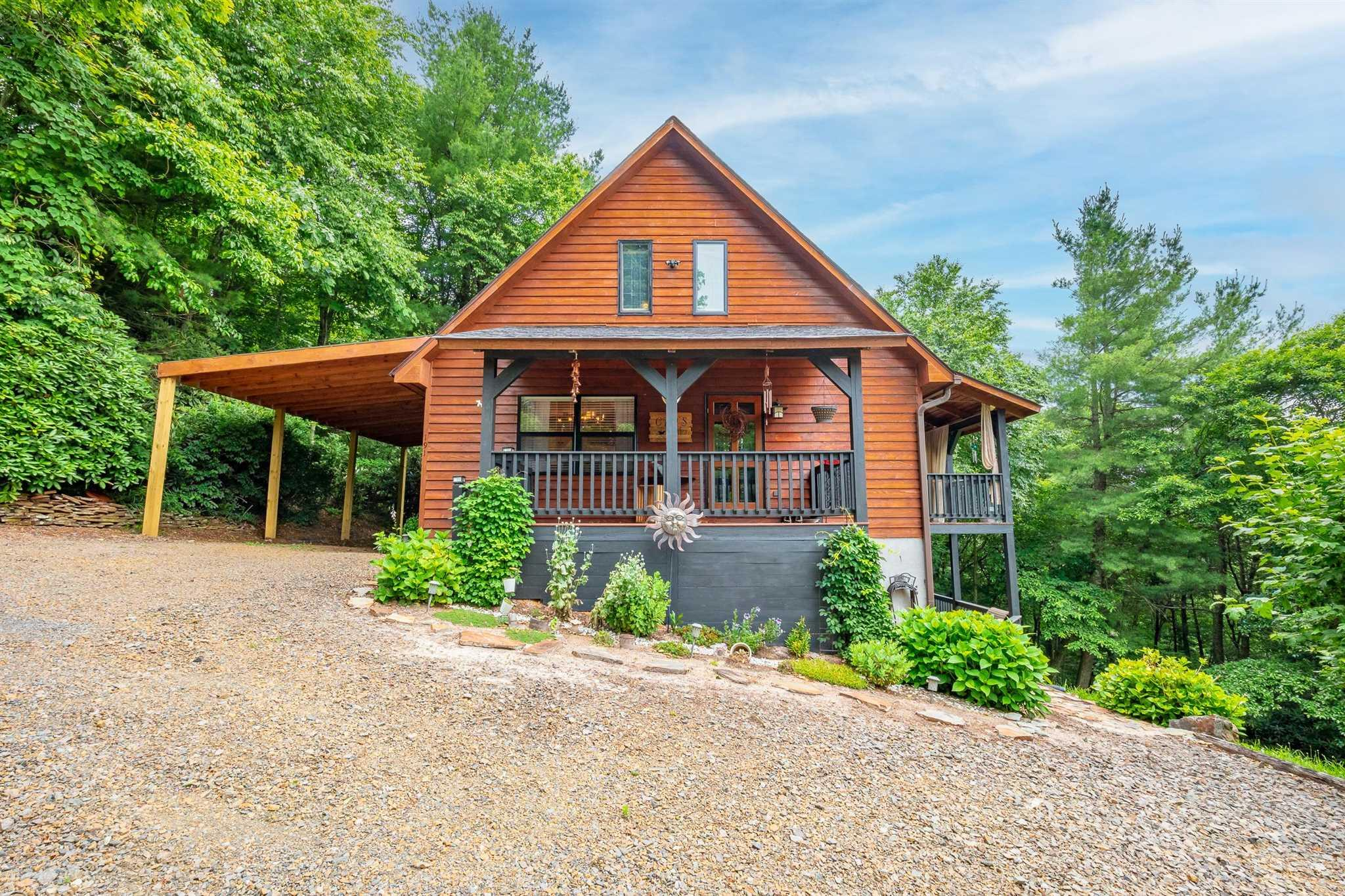 Beautiful cedar siding cabin in Chalet High just off the Blue Ridge Parkway. You have a nice view of Pilot Mountain from the deck. The home features 3 bedrooms, 2 full bath, a large loft over looking living area an open floor plan on the main level. This home is being sold fully furnished, including family entertainment room with recreation pool table, gaming / TV area, dart board, foosball table. New Roof September 2018, new flooring throughout New mini-split heat and cool system in family rec area 2020, 2 gas log stoves, large covered upper deck, large covered lower deck with porch swing, large covered front porch, new extra large covered parking area 2021. Included in your dues are the community pool, tennis courts, club house with covered picnic shelter, fishing ponds, kids play ground. You are less than half mile from Skyland Lake golf course. You are an hour from Winston Salem, an hour and a half from Greensboro, and 2 hours from Charlotte. 20 minutes for local shopping & dining.