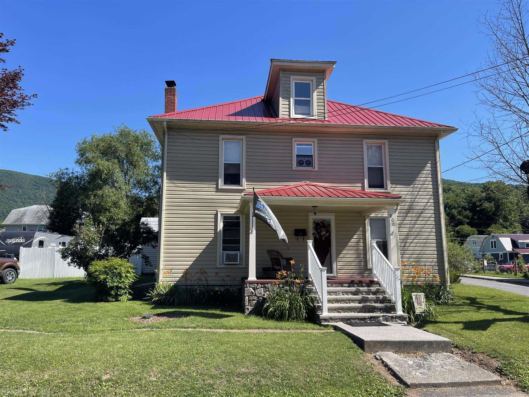Lovely older home with lots of updates! Hardwood floors, spacious rooms, 2 full baths, 16 x 32 in ground pool, large open deck, covered porch, 2 outbuildings, 2 car garage, located on 2 level lots, Lots of privacy while living in town near all the local amenities. listing agent is owner