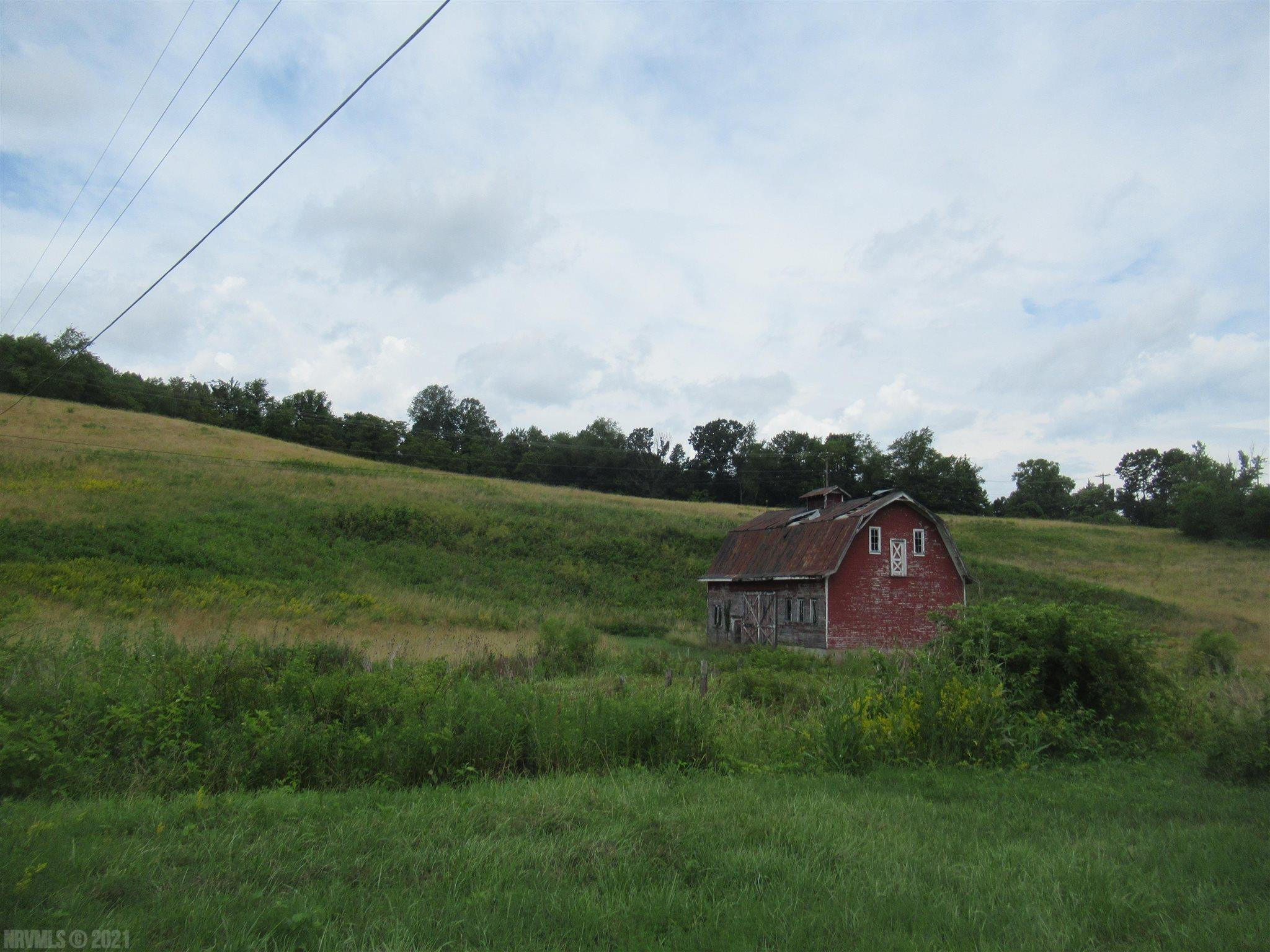 Commercial property with frontage on Rt 100, Interstate 81 and I-81 entry ramp, long frontage along the New River Trail. Public water available