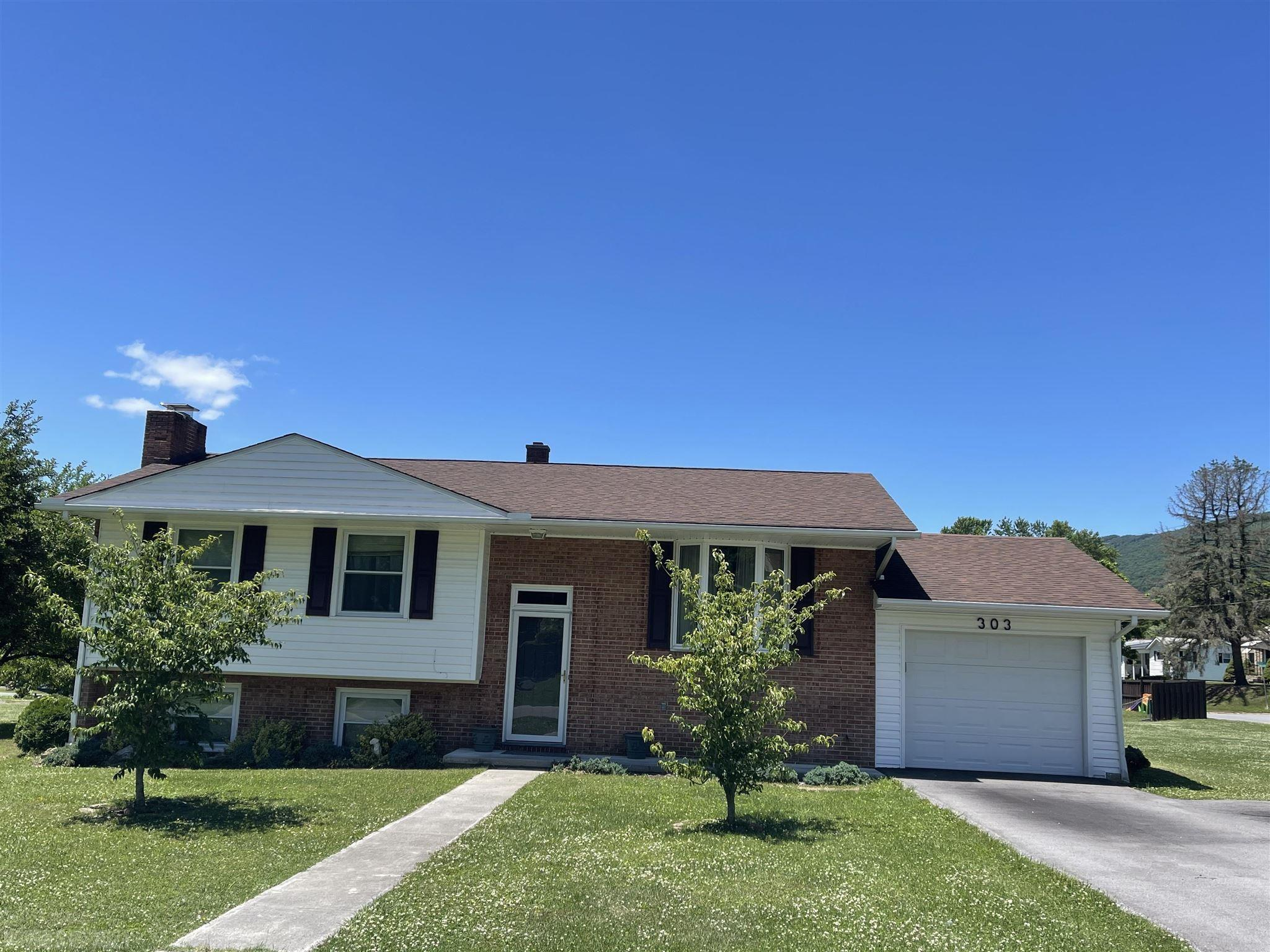 Family ready home! Newer roof, windows, vinyl siding and garage in 2011. Large screened in deck on back, large level yard in great location! A Must See!