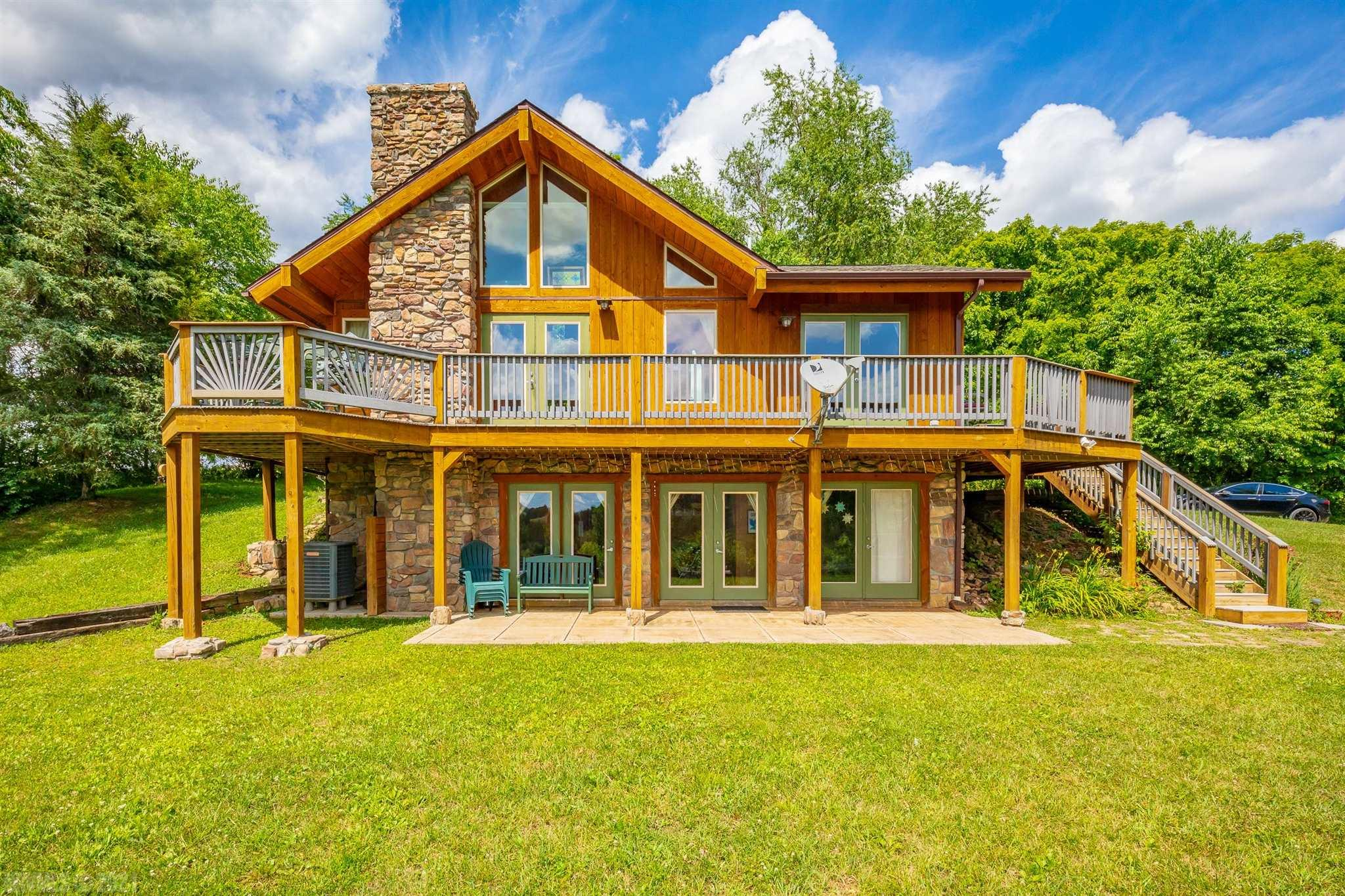 """Dreaming about the ideal get-a-way with lovely mountain views?  With 2.60 private acres you will feel you're on top of the world. With plenty of outdoors space for gardening or entertaining along with access to the wonders of Southwest Virginia. Close by is a bountiful trout stream, golf courses, a lake, hiking, biking, and shopping. The home features an open concept kitchen with 42"""" upper oak cabinets & bases topped with stunning blue pearl granite counter tops. This space includes a dining/living area adorn with cathedral ceilings & a gas log fireplace framed with tile and local artifacts. A full bath and large bedroom are also located on the top floor. A spiral stair case will carry you down to another living space. A cozy den and another bath and bedroom are found on the lower floor."""