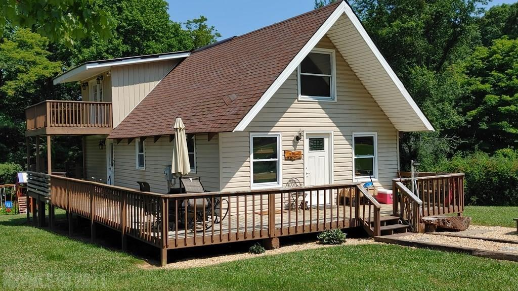 Newly remodeled A-Frame home. Less than a mile from the Blue Ridge Parkway, and just minutes to I77. This home has custom made cabinets and beautiful wood ceilings throughout with recessed lighting. Living room and dining room with an open concept that goes right into the kitchen. The master suite is upstairs, that has its own private balcony. This home is a must see to get the full effect of its charm. Nice semi level large yard with outbuilding for extra storage.