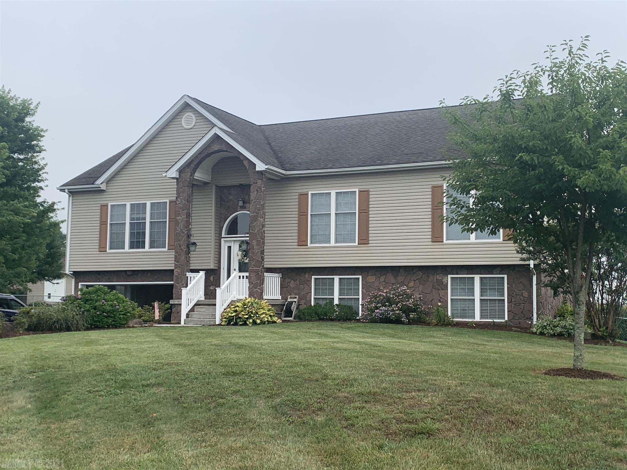 This is a beautiful home, with an amazing view off of the deck. There is also a Hot Tub to enjoy from the Patio. Lots of upgrades in the kitchen, including custom cabinets, with solid surface counter tops, under counter lighting. Also with a Gas Range. Avery nice Breakfast area adjoins the kitchen and dining room. A nice open Plan. There is a large Master Suite, with jetted whirlpool bath, shower and Walk-in closet. There are 3 Bedroom, with two full baths on main level and a third full bath adjoining the recreation room. Which can be used for a home theatre, exercise room, family room, a multi purpose room.  A very large area,  room is 30 x 30.Franch doors on the lower level lead out to a large patio with a Hot Tub. Water Heater, HP, and Refrigerator have been replaced in the last 5 years.