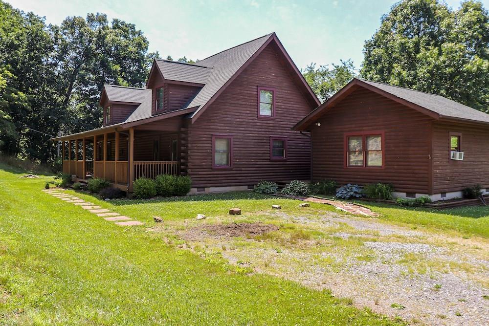 Online Only Auction - Ending August 4th @ 4 PM. Price is starting bid, not reserve. You have the opportunity to purchase a stunning log home in Narrows VA! The home features 4 bedrooms, 3 baths and was built in 2002. The main level has 2 bedrooms and over 1800 sq. ft. The upper level holds 2 more bedrooms and has 1,200 sq. ft. Enjoy the peaceful setting at your private mountain retreat in Giles County VA. Check out that beautiful rock fireplace and chimney! Kick back on the covered front porch with your loved ones, telling life stories and spending quality time together. This is truly a home that you don't want to miss out on!