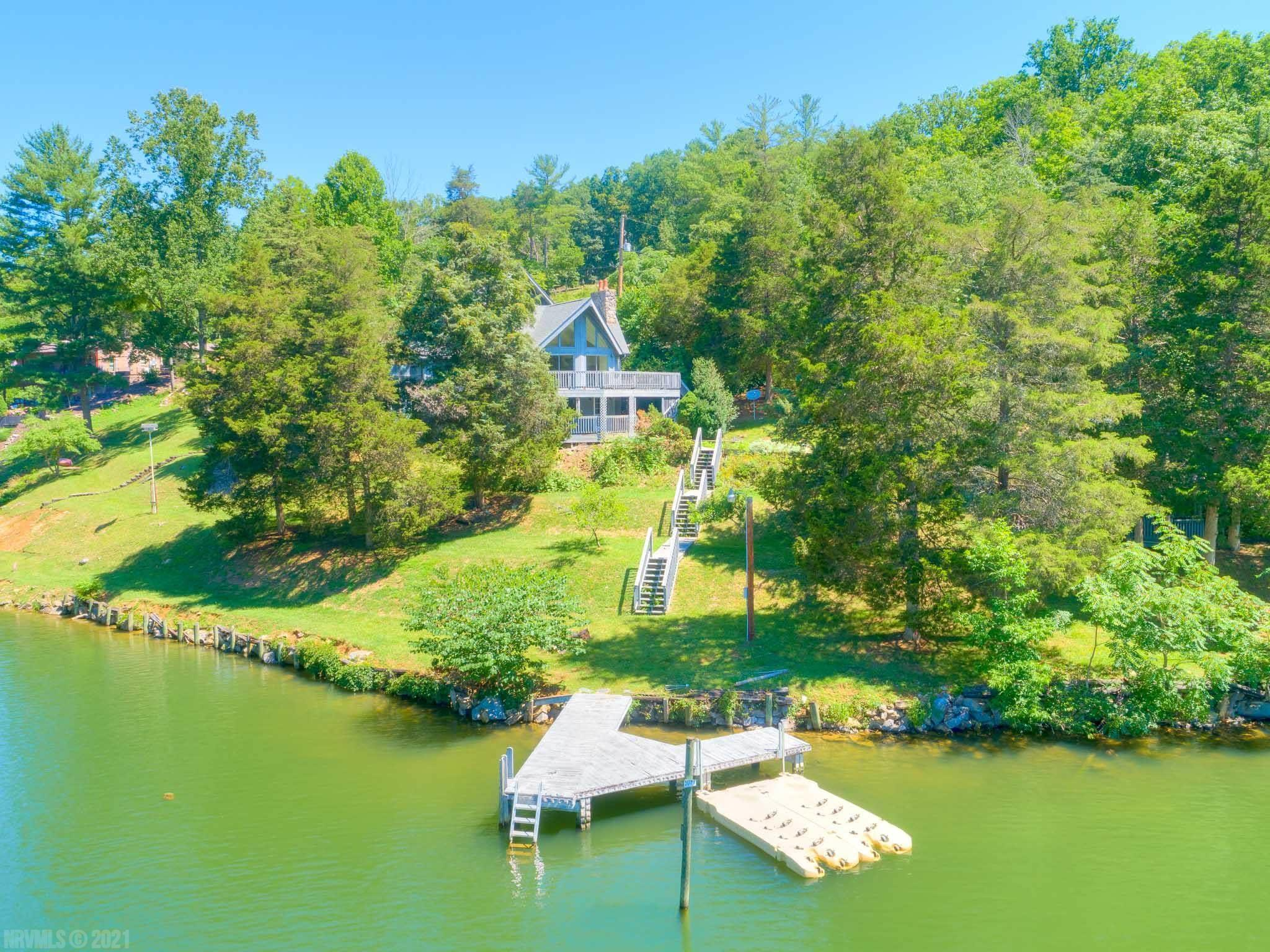 A rare find on the shoreline of Claytor Lake! Situated on over 2 acres of land with nearly 330 feet of gorgeous waterfront, this home has so much to offer. Put your finishing touches and personal preferences into this home and you'll have the perfect lake getaway or full-time home. Positioned for ultimate seclusion and privacy, this lake home has an open floor plan, main level master, large family room, two fireplaces and lots of outdoor entertaining space. The three level garage has so many possibilities! The garage upstairs has a bedroom with a half bath and the lower level has a redwood/cedar sauna, full bath and a large game room area with its own decking. The main house has three bedrooms and three baths. The roof is newer and the carpeting downstairs is new. The double jet ski pad is only two years old. Location, location, location just off the Claytor Lake exit and five minutes to I-81! Is 4799 Mecca West Drive your new home?