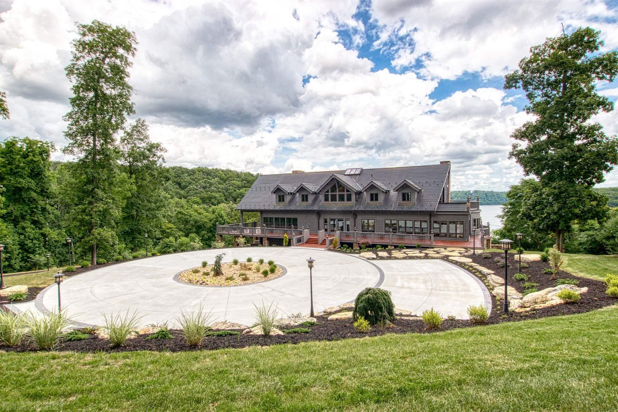 Welcome to Wish Manor! This custom built Home sitting on 23 acres with gorgeous lakefront and access. Exterior and interior of Home are cypress wood, custom built doors,  rock and stamped copper roof. Interior feature  include open floor plan,  4-5 bedrooms, 3 full and 2-1/2  baths, double kitchen with a gas Thermador 6 burner range and a  electric Jenn Air range, Viking refrigerator/freezer, 1 full size and 2 drawer dishwashers and an elevator. Master bedroom on main level with walk in tile shower, Master Suite on upper level with private laundry and walk in shower and separate tub. Entertain your friends and family in the Great room with gorgeous rock fireplace, full bar area, media area and private deck. The 5,350 sq ft of pressure treated decking offers room to entertain with lake views. This property boasts a boat dock with party deck, 2 boat lift and  2 jet ski lifts. Additional detached 1 car garage with 1/2 bath as you approach the house. Multiple heat pumps and water heaters.