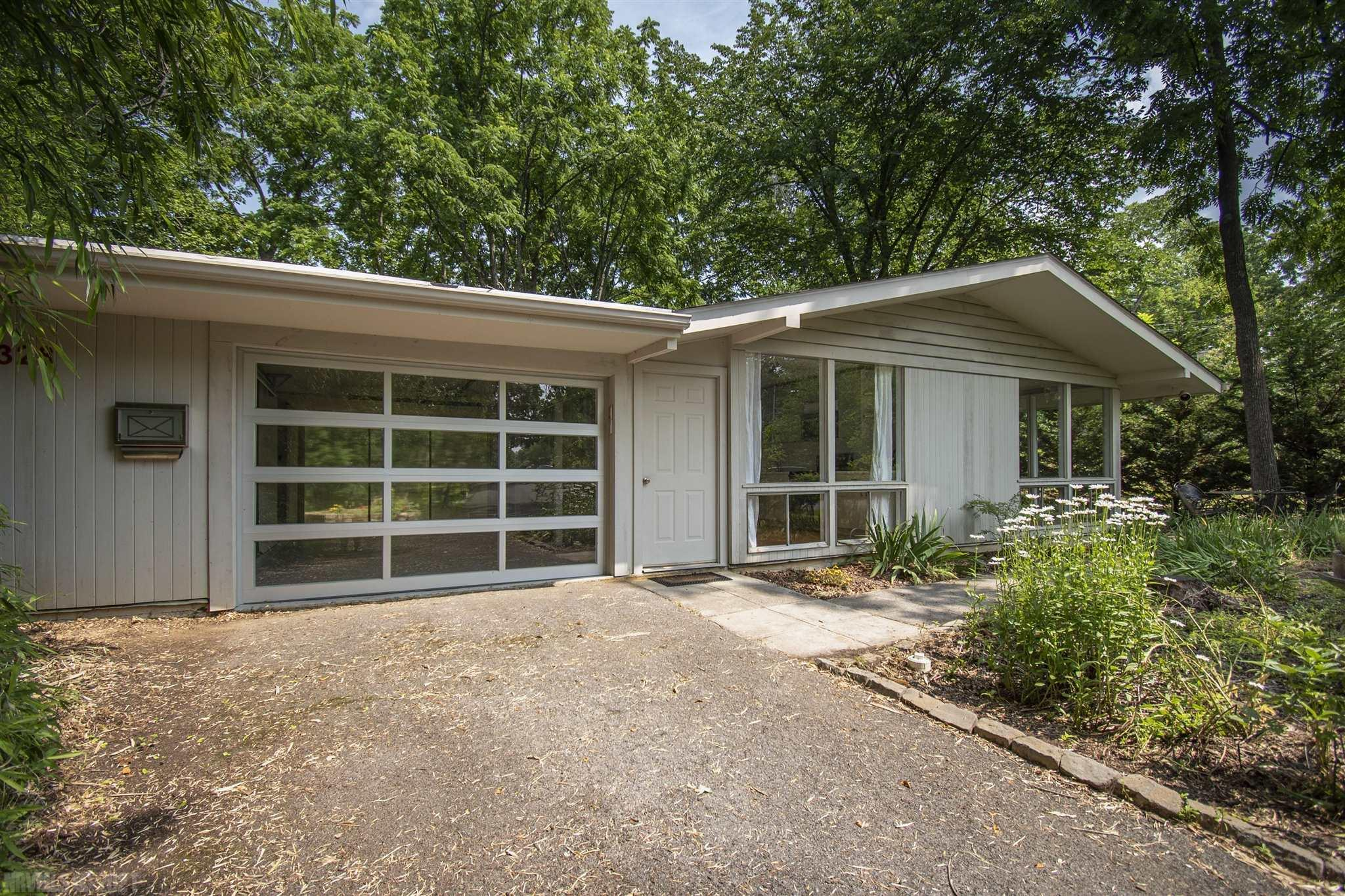"""Own a Piece of ARCHITECTURE HISTORY  in the coveted Miller Addition neighborhood.  This award winning home was a collaborative project in 1955 between VPI, National Home Builders Association, a New York City magazine and a national Nail Company to show how a young family could live comfortably in a small, modern home.  So much engineering and planning went into this house that it was nick named """"The House That Nails Built.""""   In true Mid-Century Modern style this home features floor to ceiling windows with an abundance of sunlight reflecting off crisp white walls and gleaming hardwood floors. Every inch of this home is well thought out and the location cannot be beat: walk to Downtown or to Lane Stadium."""