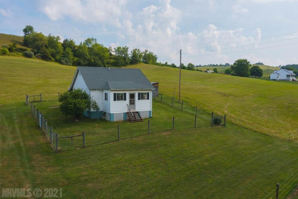 Online Only Auction - Ends August 12th @ 4 PM. Price is starting bid, not reserve. You have the opportunity to purchase a beautiful farm for sale in Draper VA! This property features 10.628 acres of open farmland and a small, one story home. The home has 2 bedrooms, 1 bath, 728 sq. ft., a new shingle roof, carpet, vinyl and laminate hardwood flooring, and propane heat. There is a private well and septic. The property is accessed by a right of way. The neighbor has rights to the spring located in the springhouse on the property.
