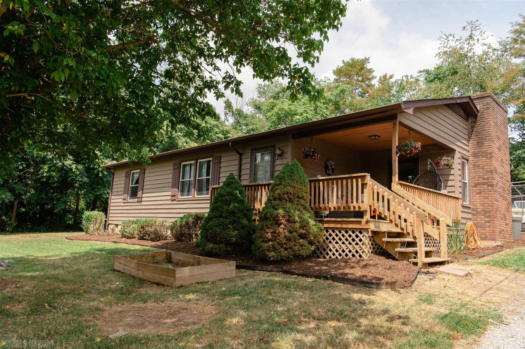 Don't miss this cute gem in the perfect location in Christiansburg.  One level living, on a beautiful one acre lot with lots of charm.  This home has 2 bedrooms with 1 bath, large kitchen area, fireplace insert, cozy front porch, and huge detached garage. Make your appointment today.