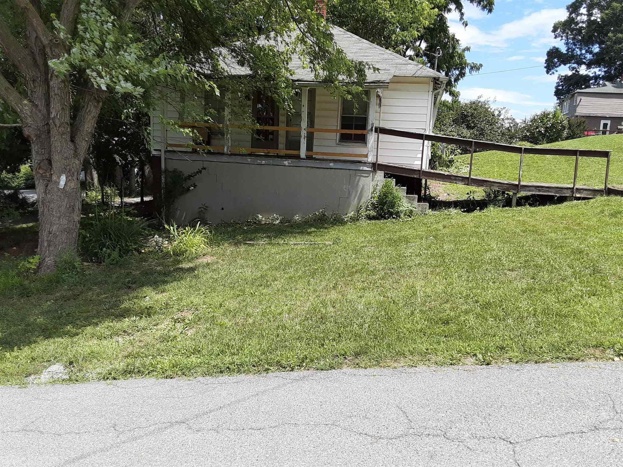 Great fixer upper with a nice size yard and shop in the back for working on that next hobby or project! Just up the road from the New River for outdoor activities and close to shopping! Property is zoned R-3 with all public utilities. Home is being sold AS-IS, WHERE-IS.