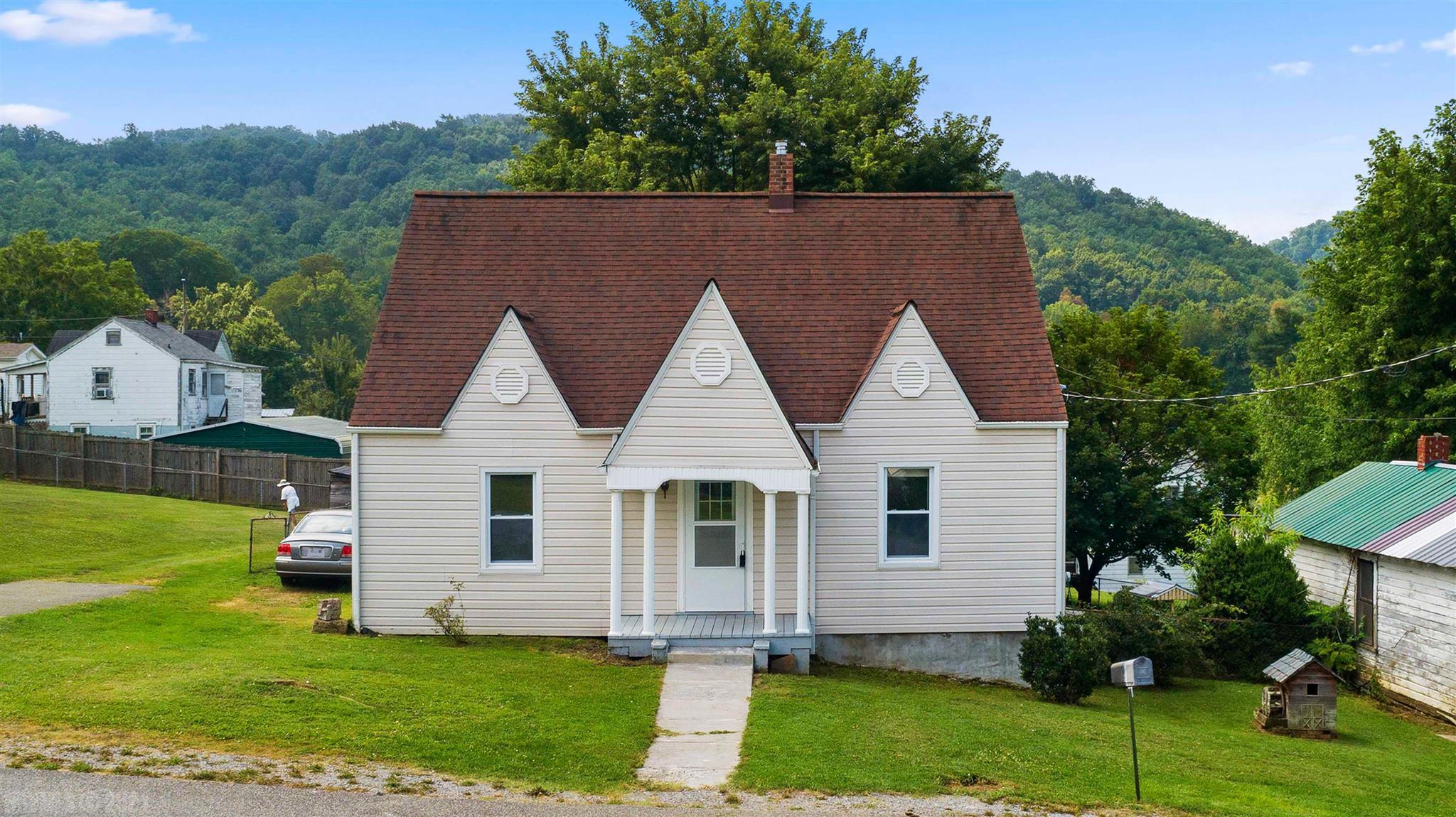 NEW Vinyl Siding-1999, NEW Shingle Roof & NEW Hot Water Heater - approx. 2015, NEW Replacement Vinyl Windows-2015, NEW Extra Insulation-2015, NEW Storm Door-2015, Public water line has been replaced. NEW Metal Roof-Storage Bldg which is 55.75 x 14. Large Home w/3 BR, 1 Bath, LR, Kitchen, DR, Hall, & Laundry in 1,221 SF on the Main Level w/Hardwood Floors. Pull down stairs to attic & check about the possibility of putting permanent stairs to Attic w/1,221 SF & plenty of Room to put 2 Bedrooms & Full Bath. Partial Basement has 4 rooms & sump pump. LARGE Level Corner YARD of est. .55 acre. PLUS  Rear Yard is fenced &  Plenty of Room for Garden. Excellent location on corner lot. Front Porch & L-Shaped Rear Deck are covered. Basement Access off Laundry & Outside entrance also.  Heat - Hot Water Natural Gas. Sold as is where is. Seller will not pay for any repairs or Termite Inspection. Buyer can do Home Inspection & Radon for his information. Upper UF SF is Attic.